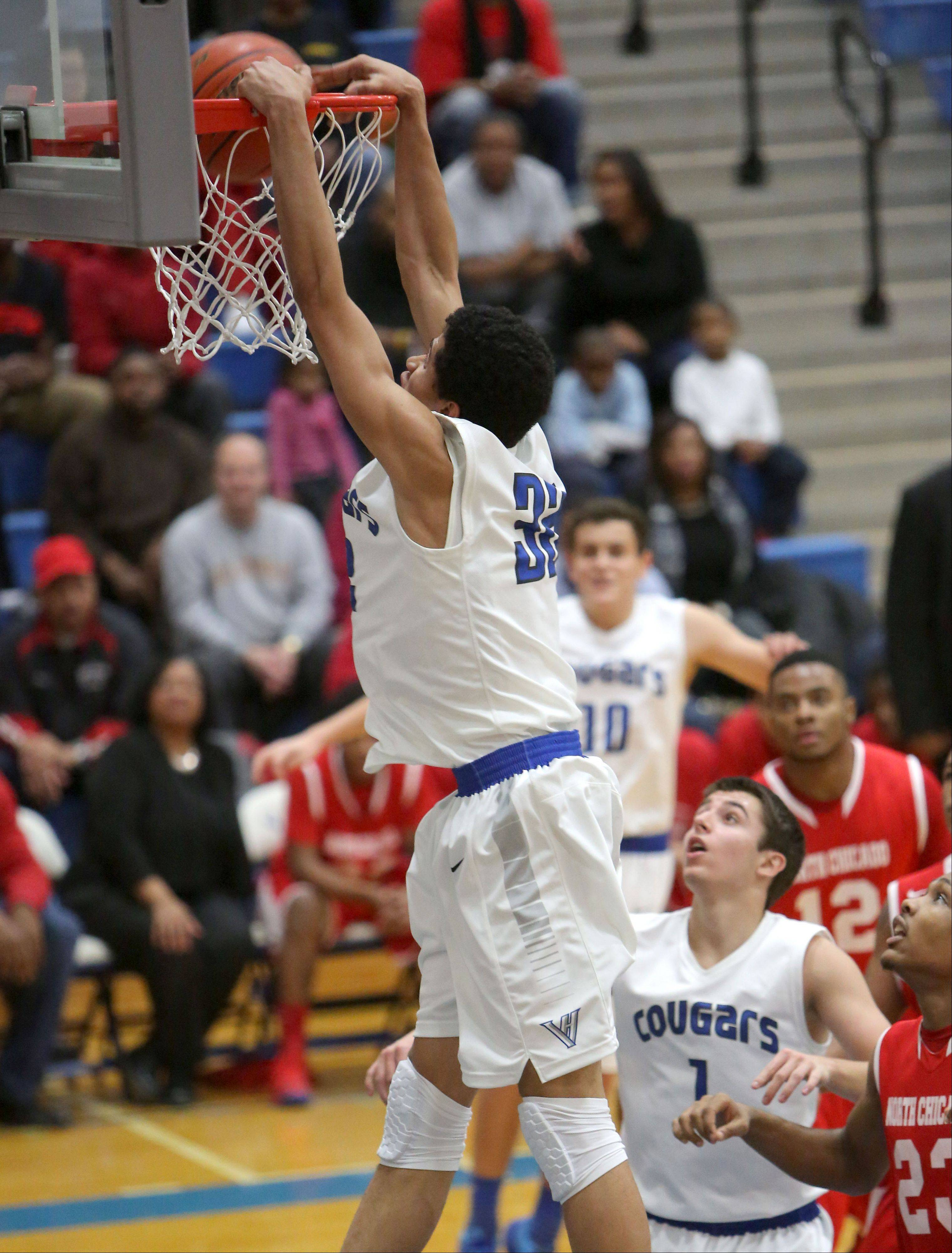 Vernon Hills' Lem Turner goes in for a slam dunk.