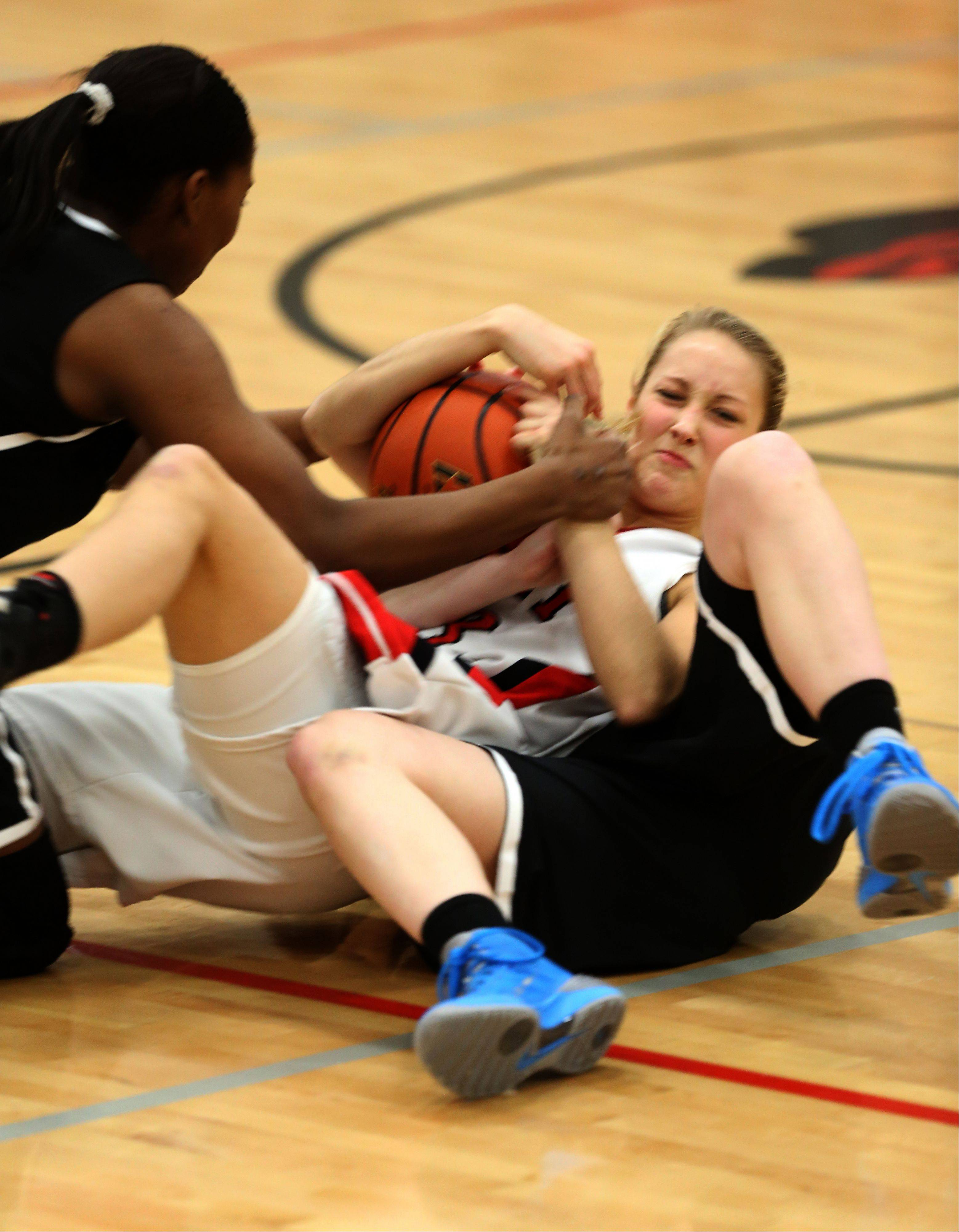 Benet's Emily Eshoo battles for a loose ball against Fenwick.
