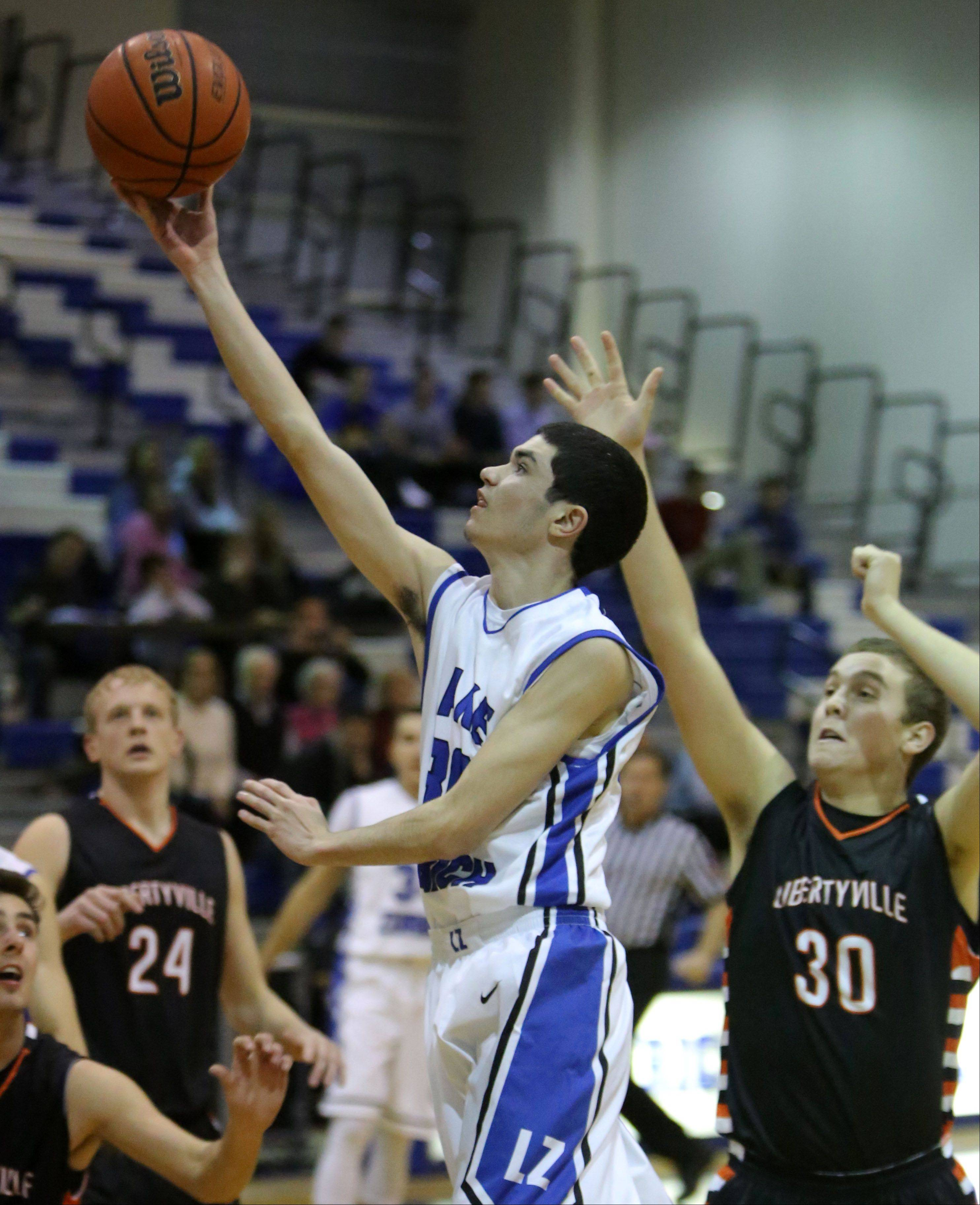 Lake Zurich's Jack O'Neill, left, drives past Libertyville's Ben Kimpler on Wednesday night at Lake Zurich High School.