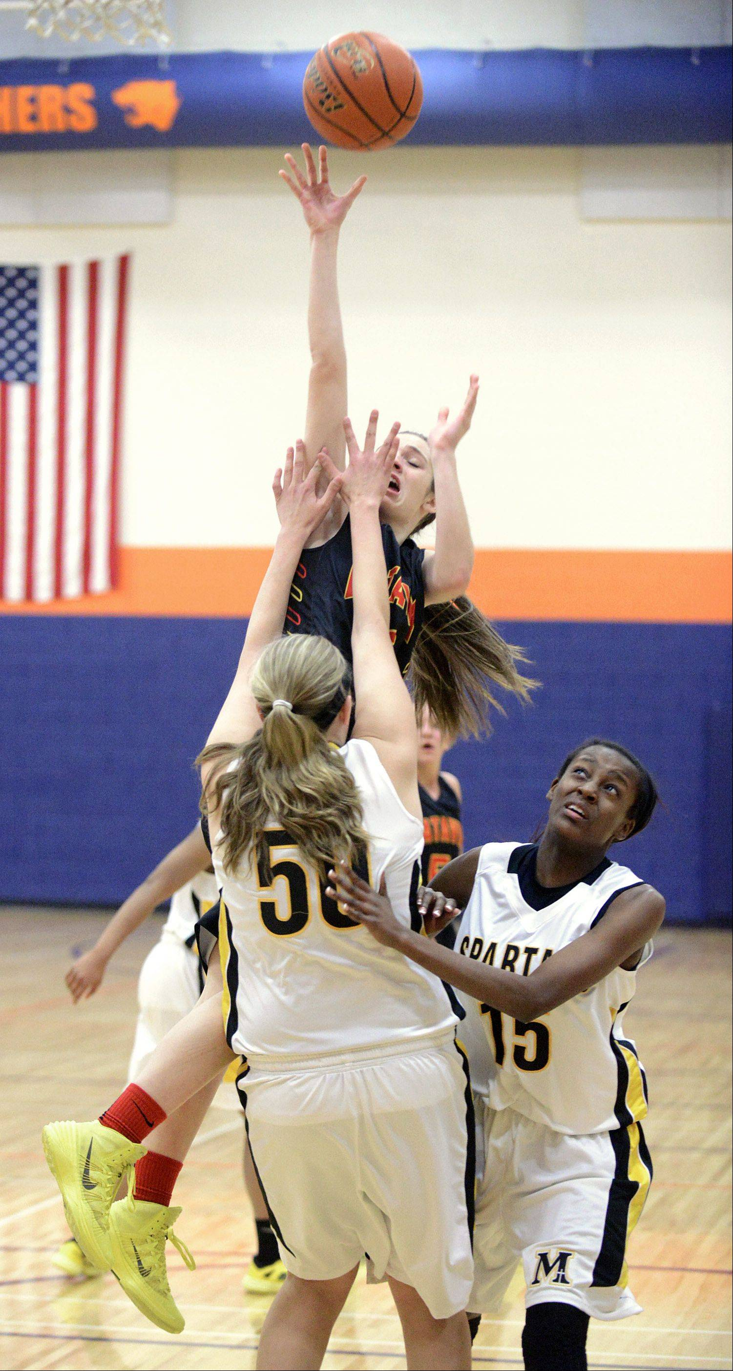 Batavia's Mackenzie Foster shoots over Marian Catholic's Kaitlyn Sedor in the first quarter on Wednesday, December 18.