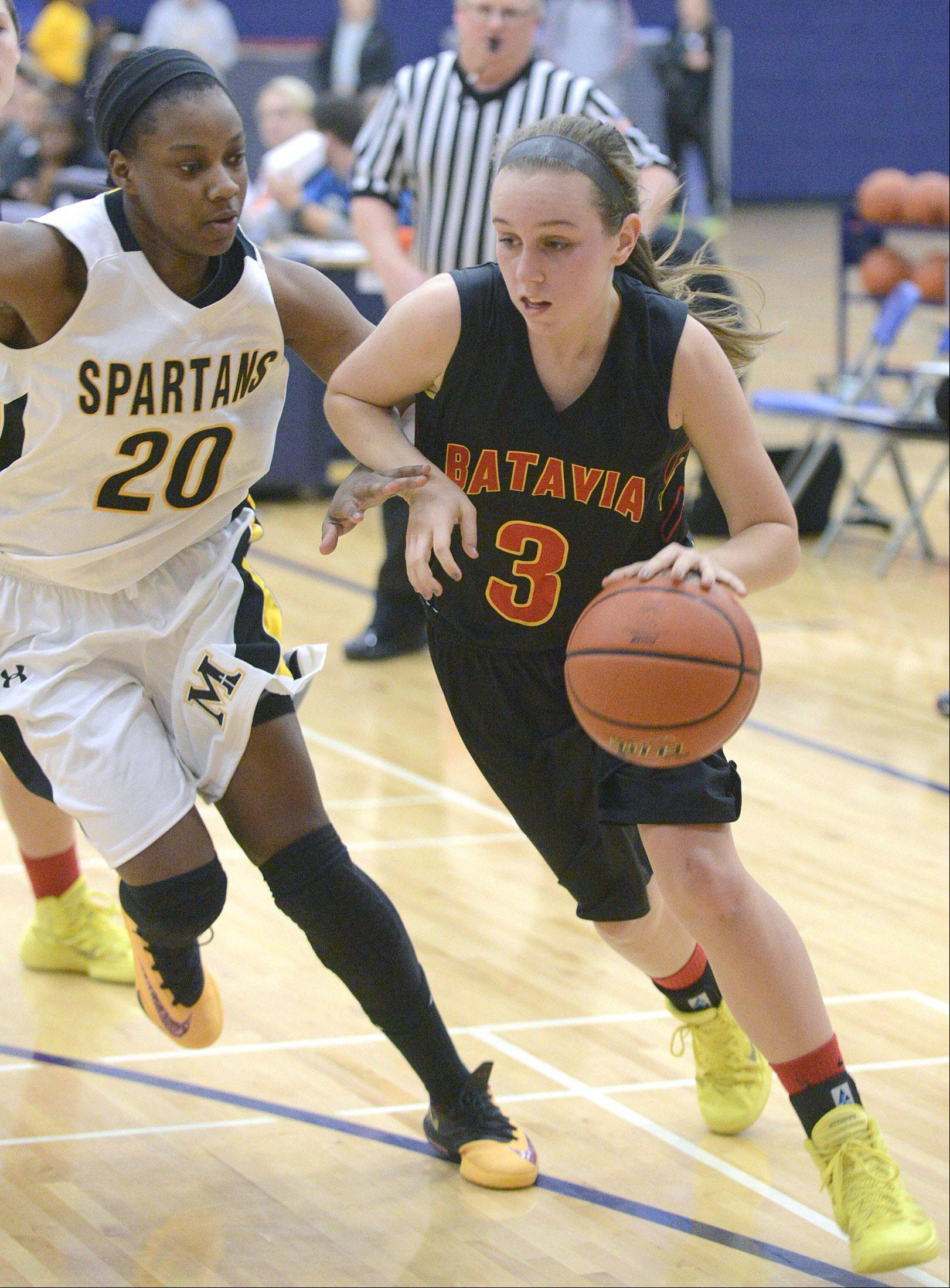 Batavia's Bethany Orman drives the ball to the hoop around Marian Catholic's Dajhae Mullins in the third quarter on Wednesday, December 18.