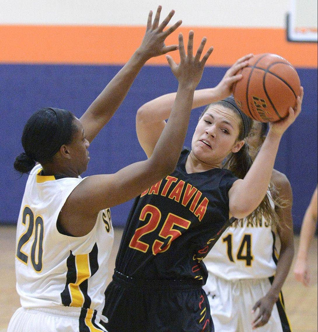 Batavia's Hannah Frazier attempts to pass around Marian Catholic's Dajhae Mullins in the first quarter on Wednesday in Oswego.
