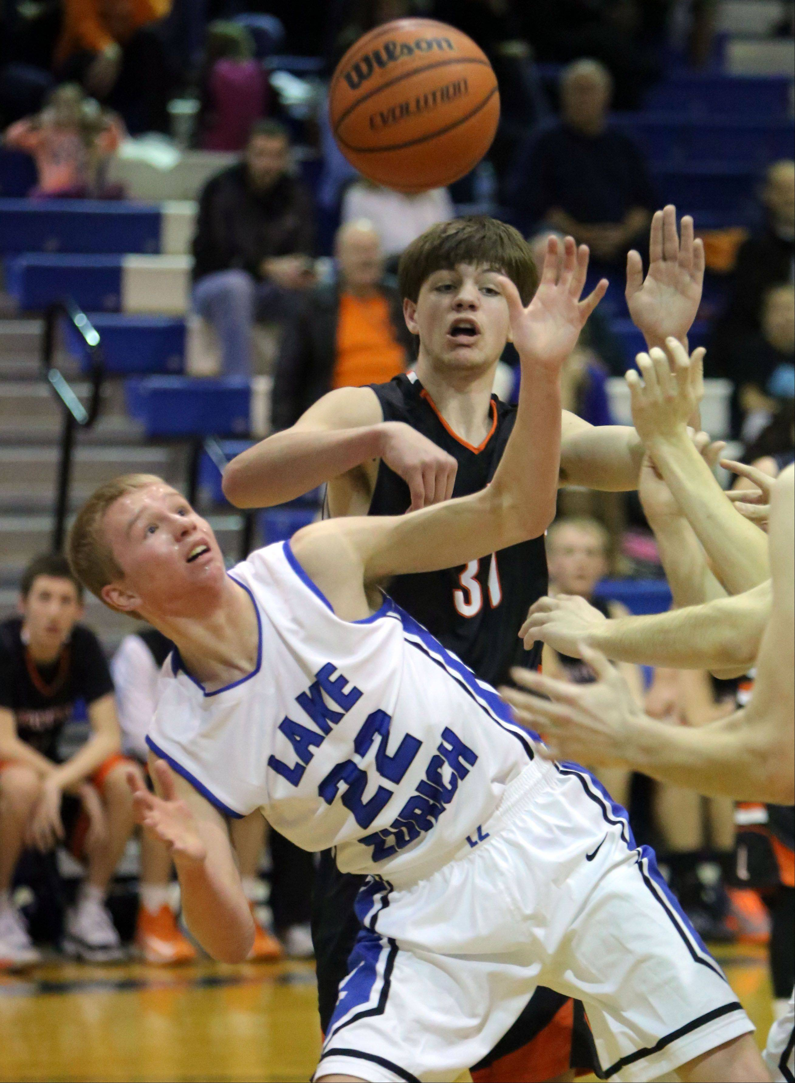 Lake Zurich's Brad Kruse, left, and Libertyville's Joe Borcia battle for a rebound .