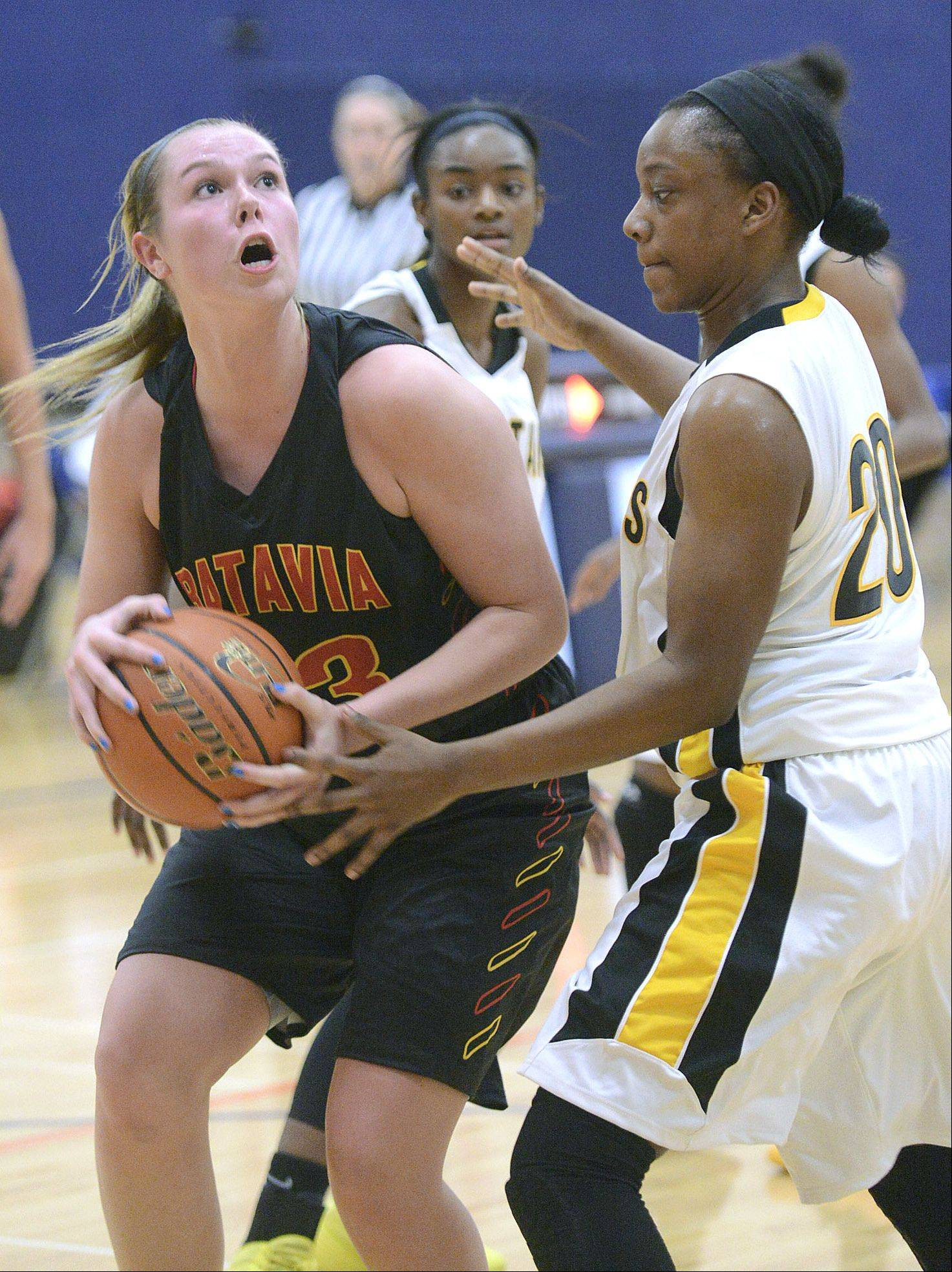 Batavia's Erin Bayram attempts a shot around Marian Catholic's Dajhae Mullins in the second quarter.
