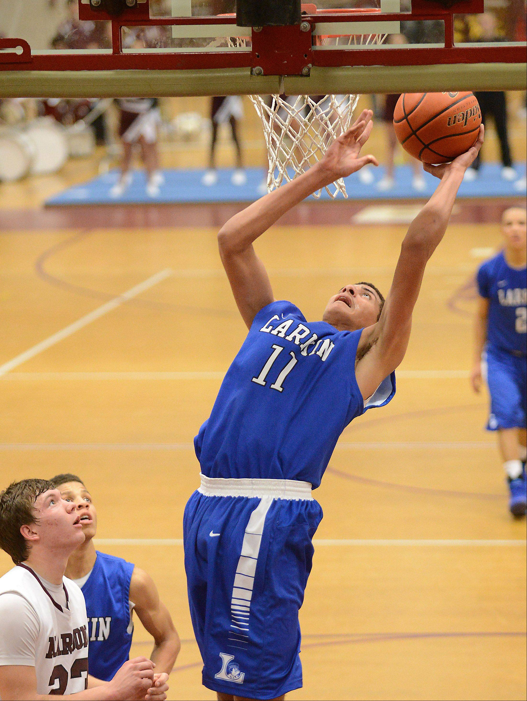 Larkin's Christian Negron (11) goes up alone under the basket during Thursday's game at Elgin.