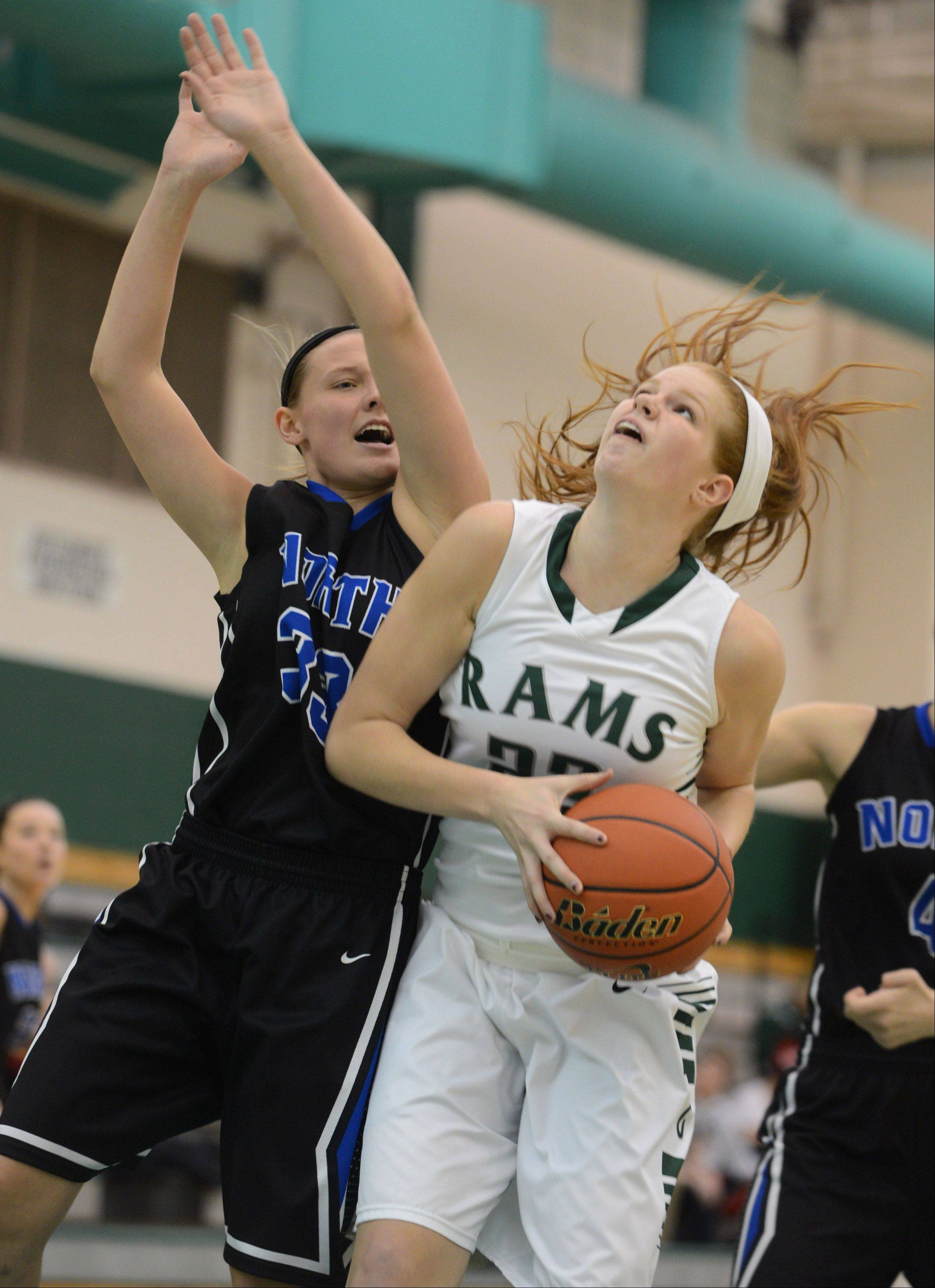 St. Charles North's Nichole Davidson (33) tries to stop the efforts of Grayslake Central's Morgan Dahlstrom on Thursday in Grayslake.