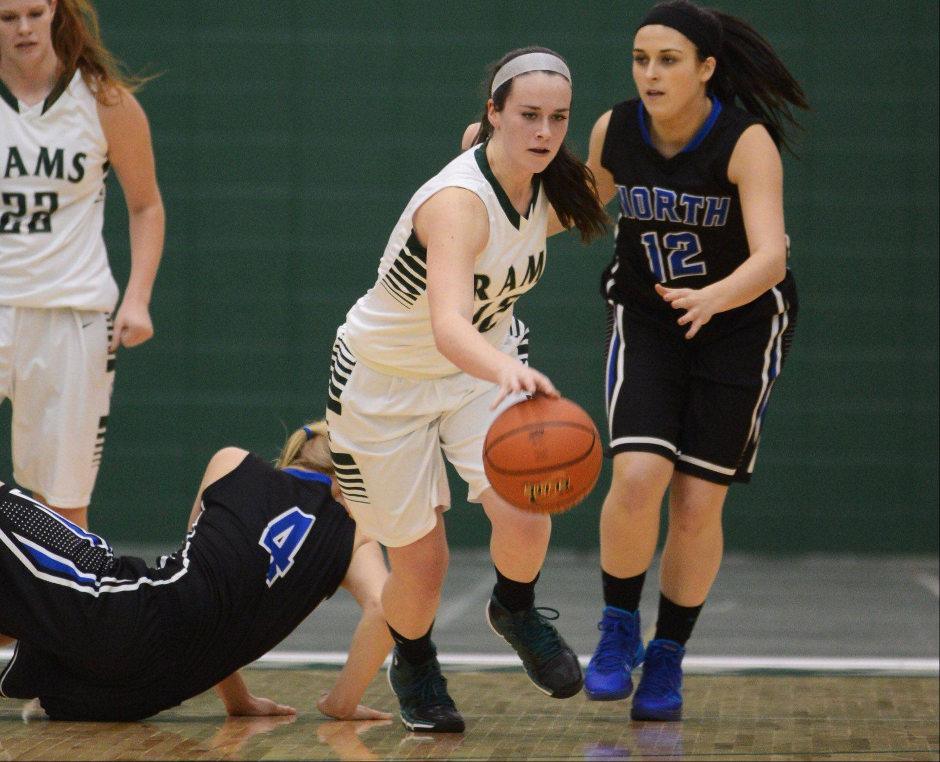 Grayslake Central's Kelly Moroney, center, gets to the loose ball ahead of St. Charles North's Sam Henry Thursday in Grayslake.