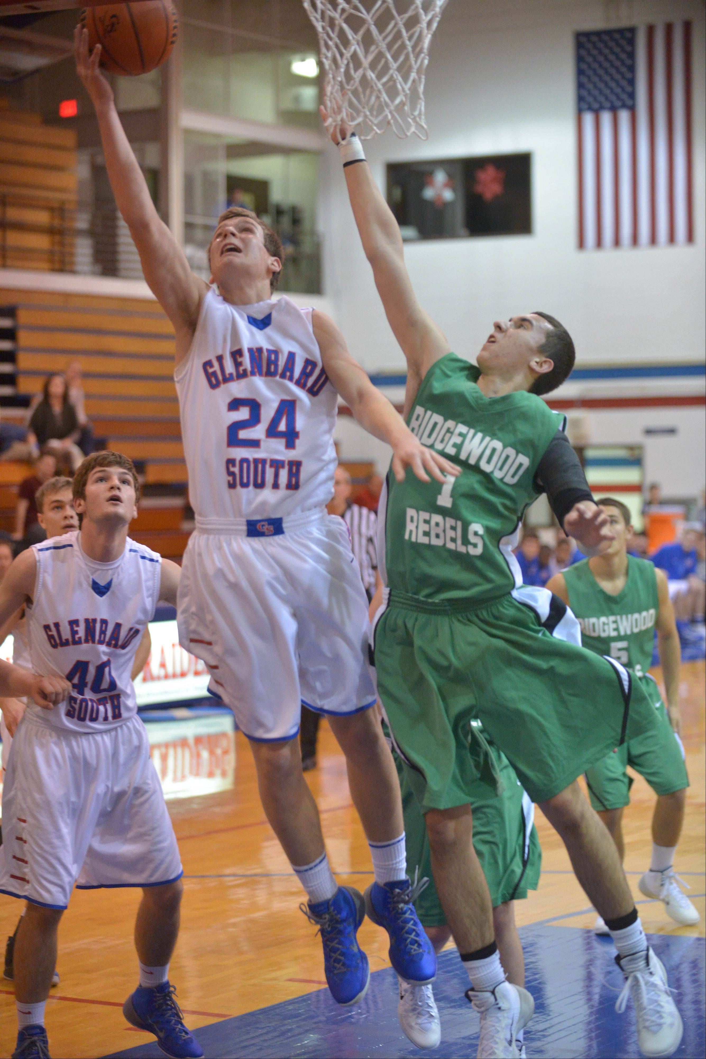 Alex Jeske of Glenbard South takes a shot over Brian Burack of Ridgewood.