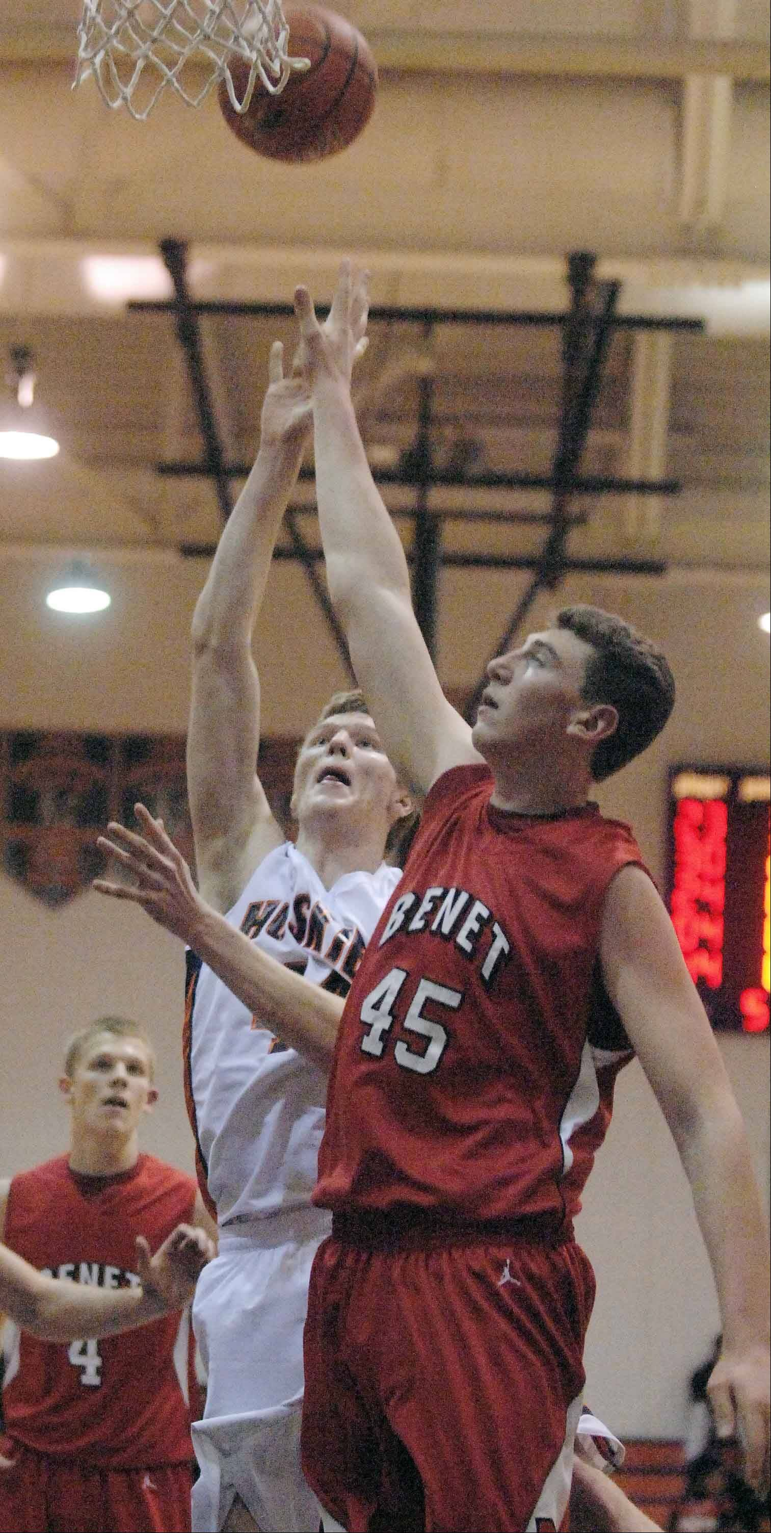 Mike Johnson of Naperville North,left, and Sean O'Mara of Benet go up for a rebound. This took place during the Benet at Naperville North boys basketball game Tuesday.