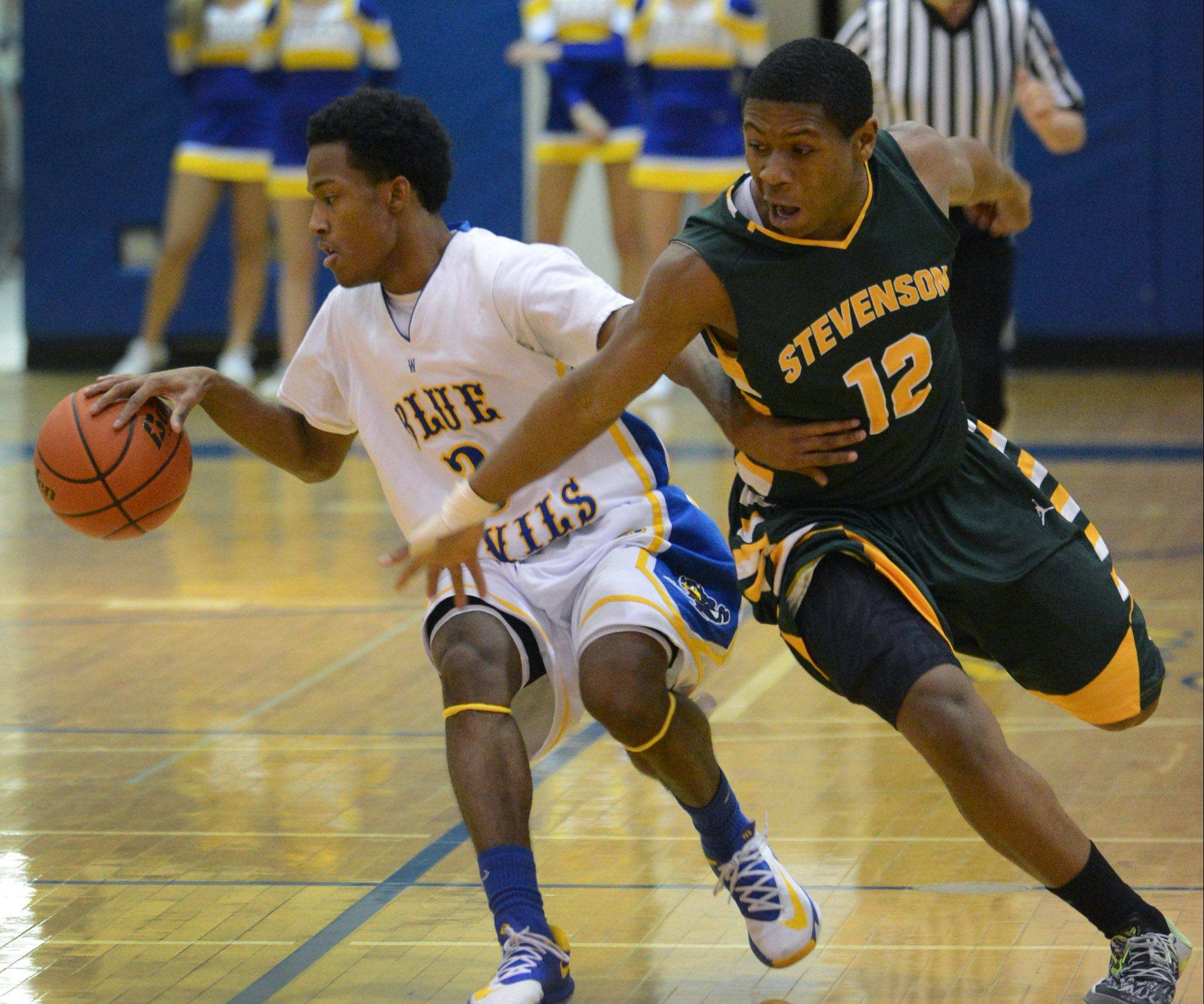 Stevenson's Matthew Johnson (12) attempts the steal on Warren's Eric Gillespie on Friday in Gurnee.
