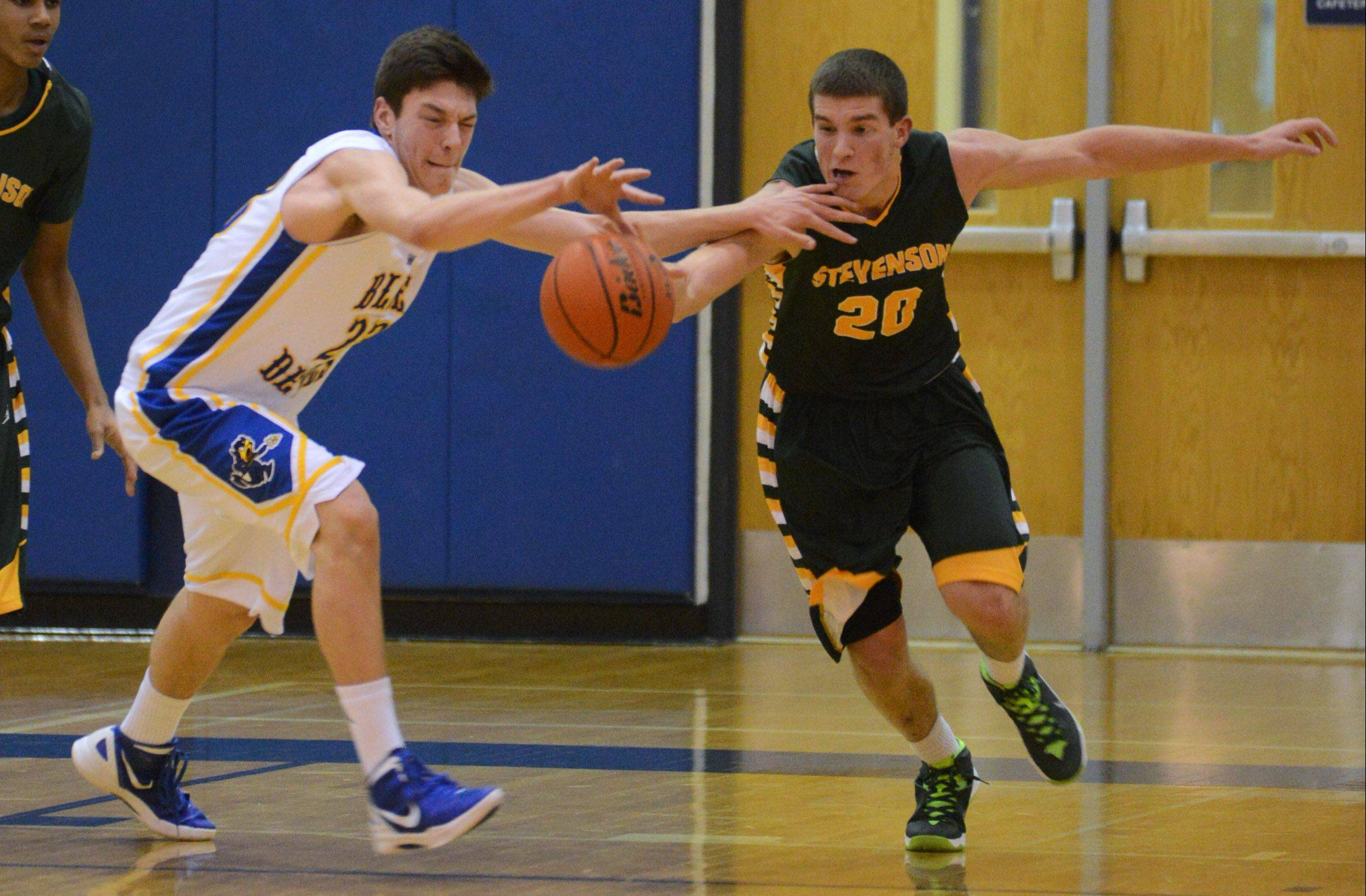 Warren's Jovan Jokic, left, and Stevenson's Matthew Morrissey race to the ball during Friday's game in Gurnee.
