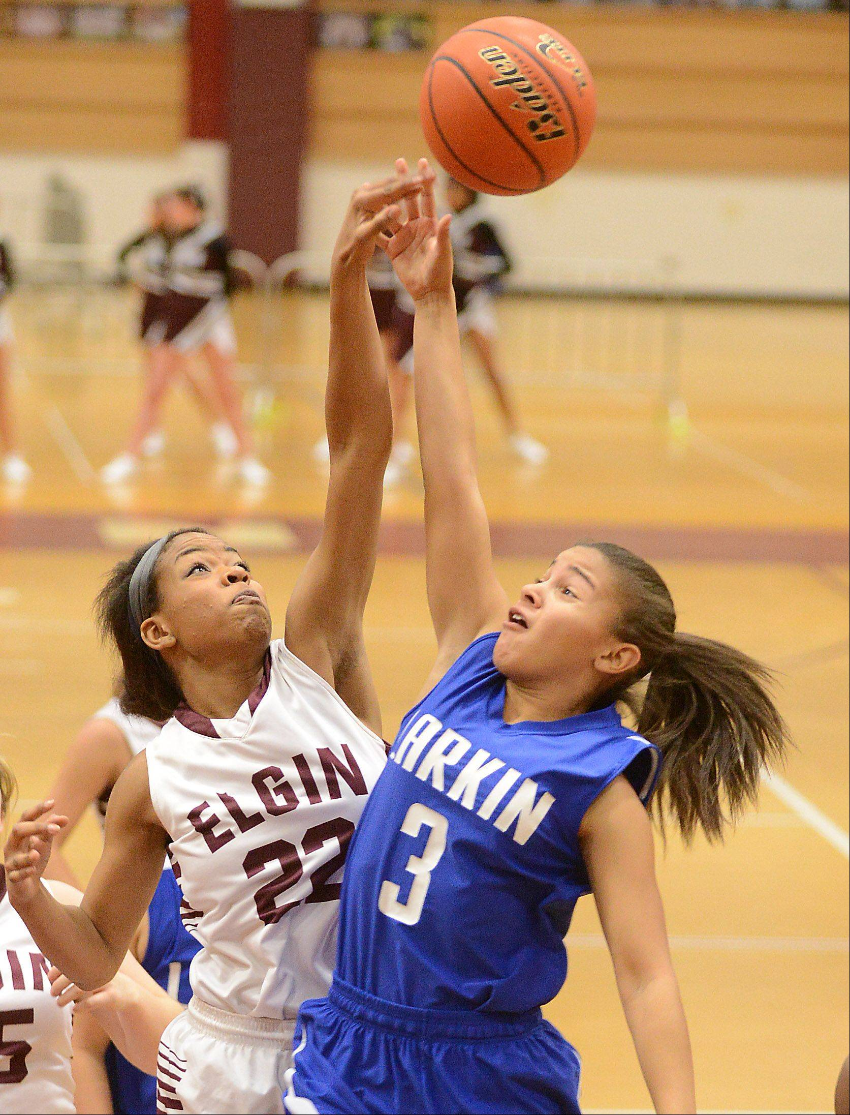 Elgin's Abby Pierre-Louis (22) blocks a shot by Larkin's Marlee Kyles (3) during Friday's game at Elgin.