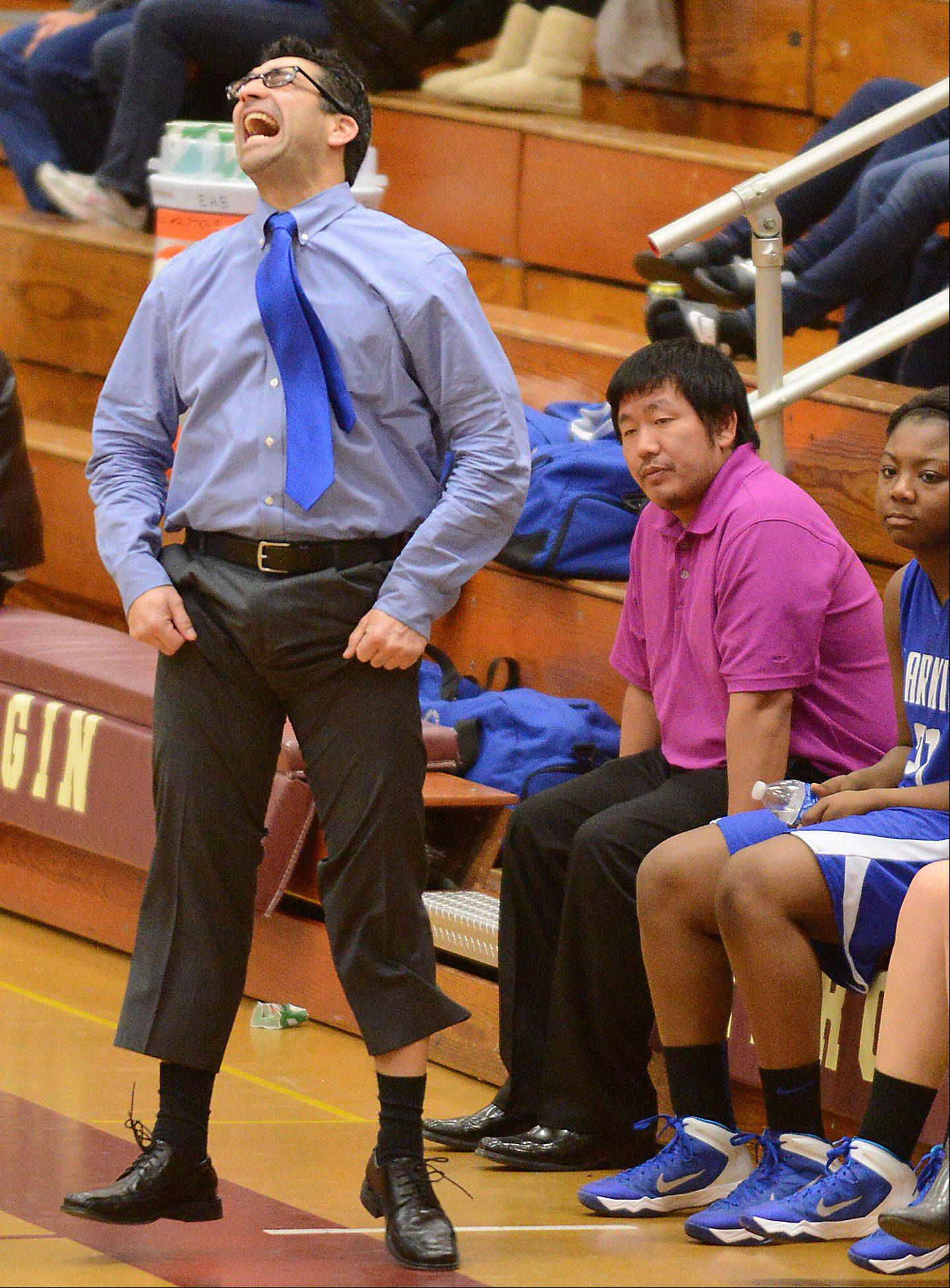 Larkin coach Ruben Flores doesn't like what he sees from his team during Friday's game at Elgin.