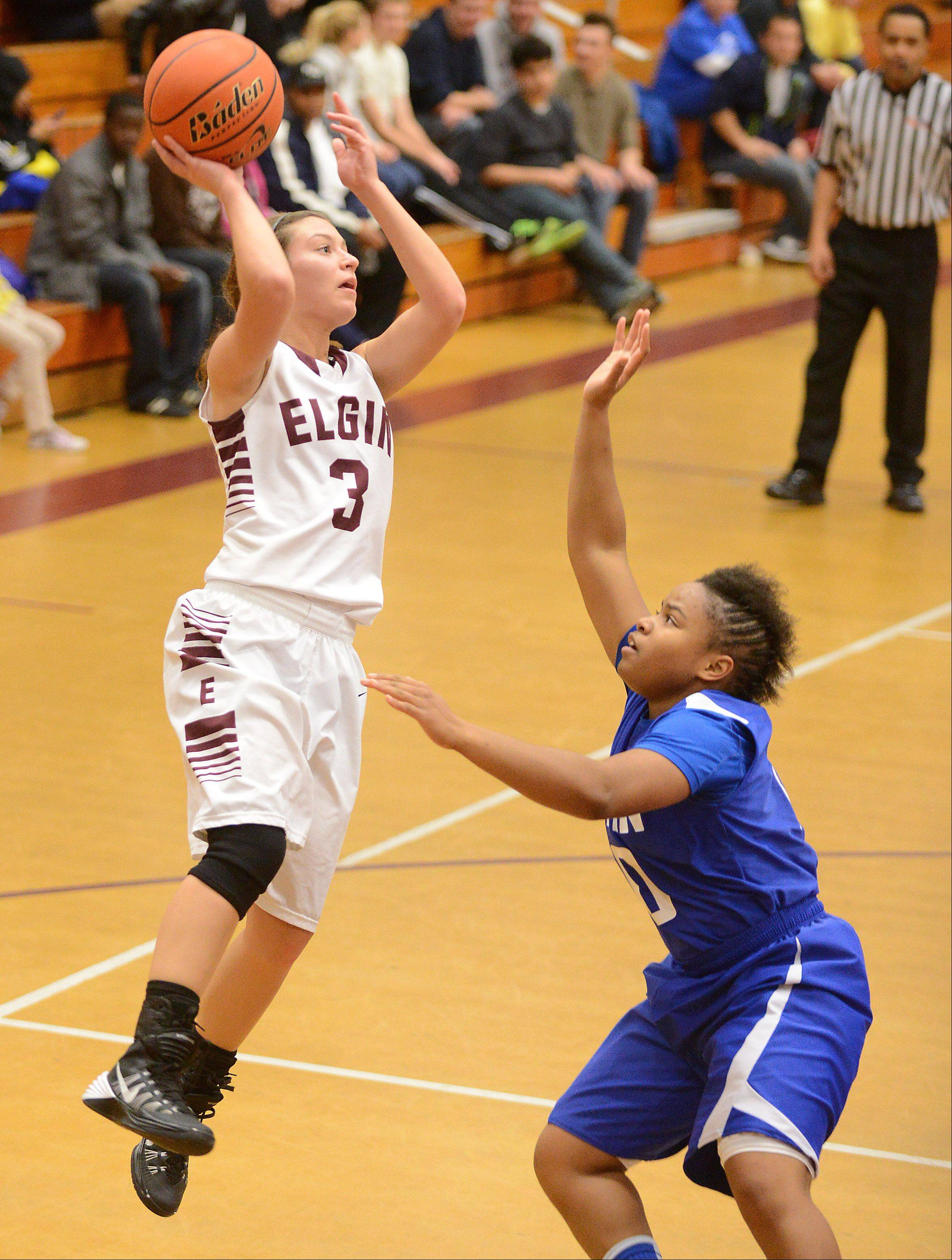 Elgin's Maggie Powers (3) shoots over Larkin's Quixmia Washington (20) during Friday's game at Elgin.