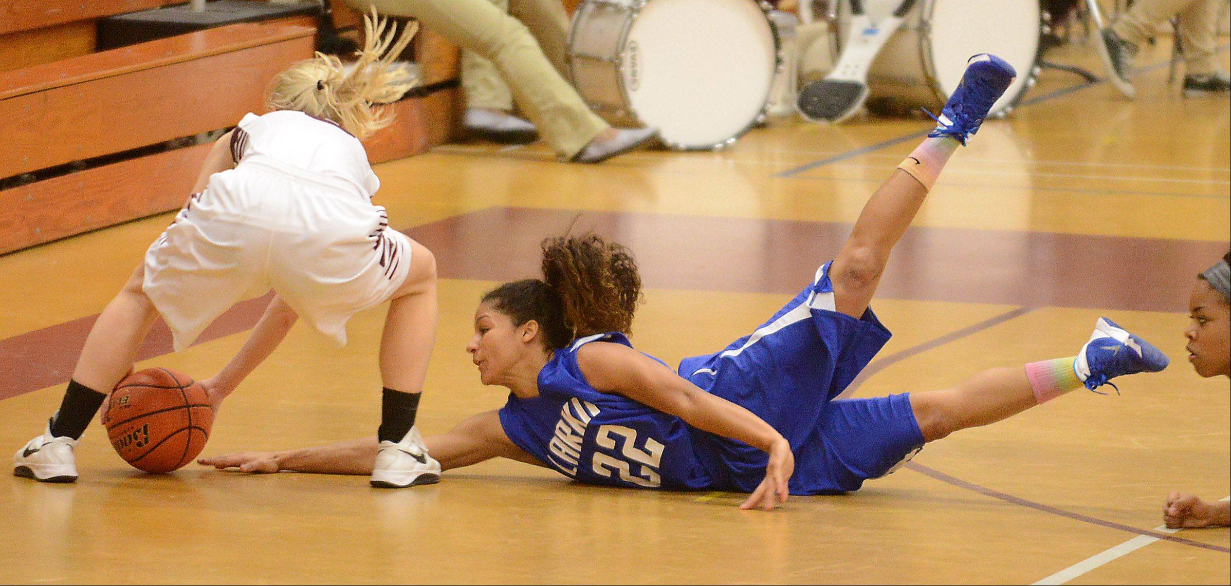 Larkin's Victoria Patterson (22) dives for a loose ball that is picked up by Elgin's Melanie Berg (5) during Friday's game at Elgin.