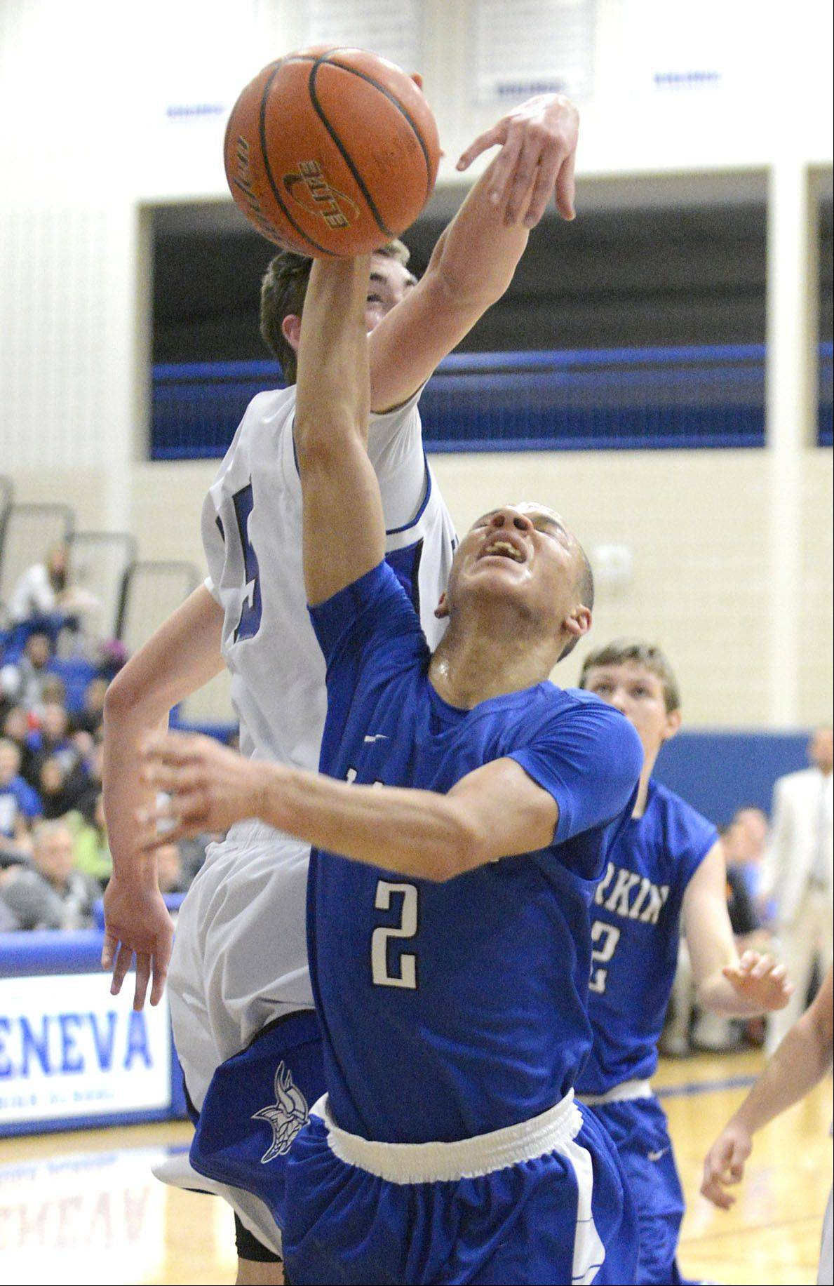 Geneva's Nate Navigato denies Larkin's Derrick Streety a basket in the first quarter.