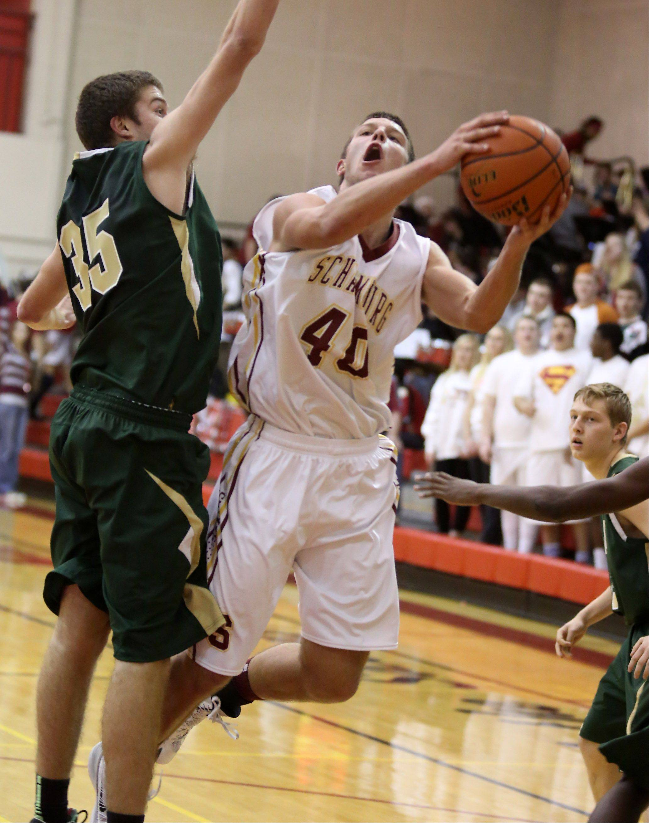 Schaumburg forward Joshua Rahn puts the ball up against Fremd defender Thomas Cordell.