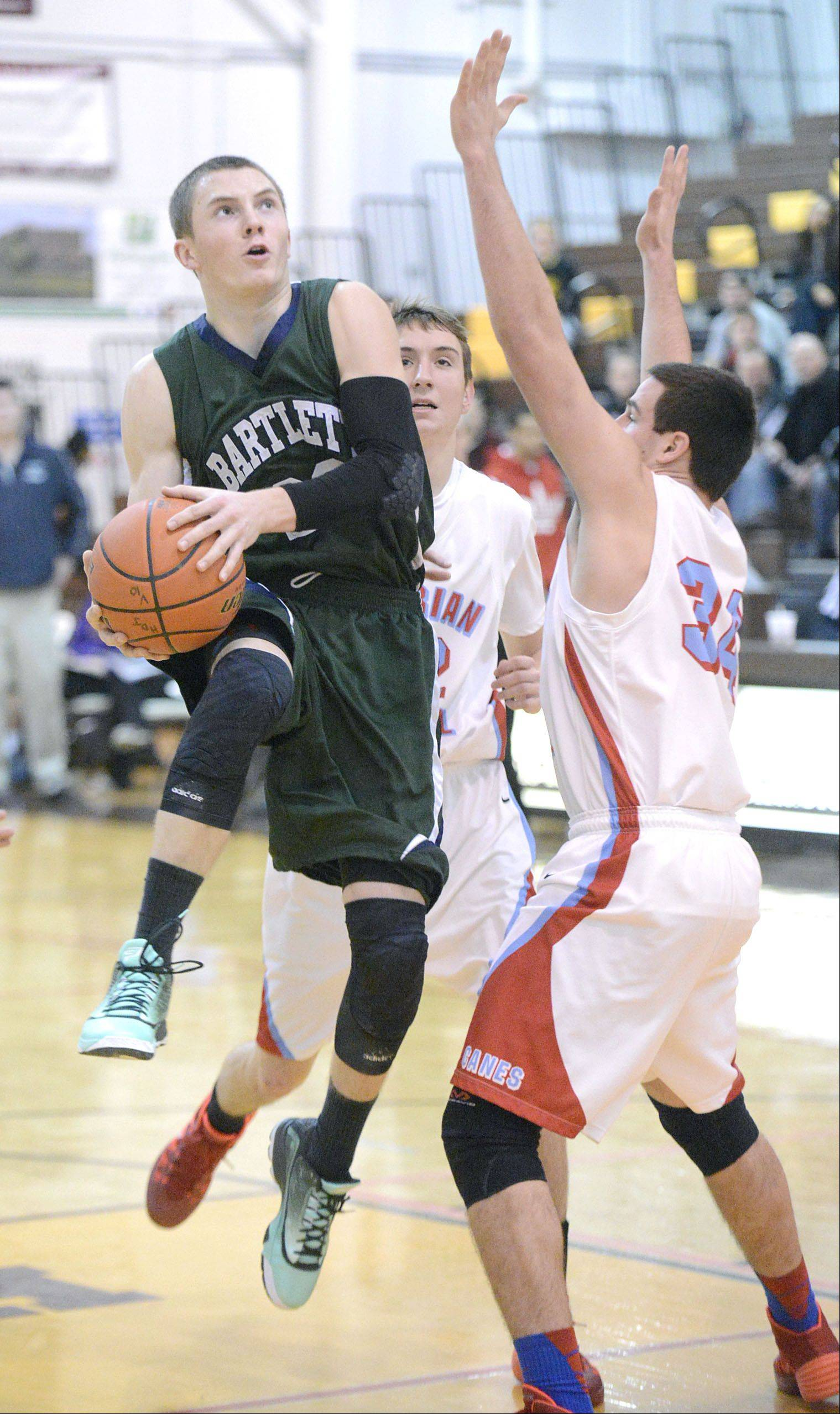 Bartlett's Ryan DiCanio shoots past a block by Marian Central's Matthew Ricchiuto in the first quarter.