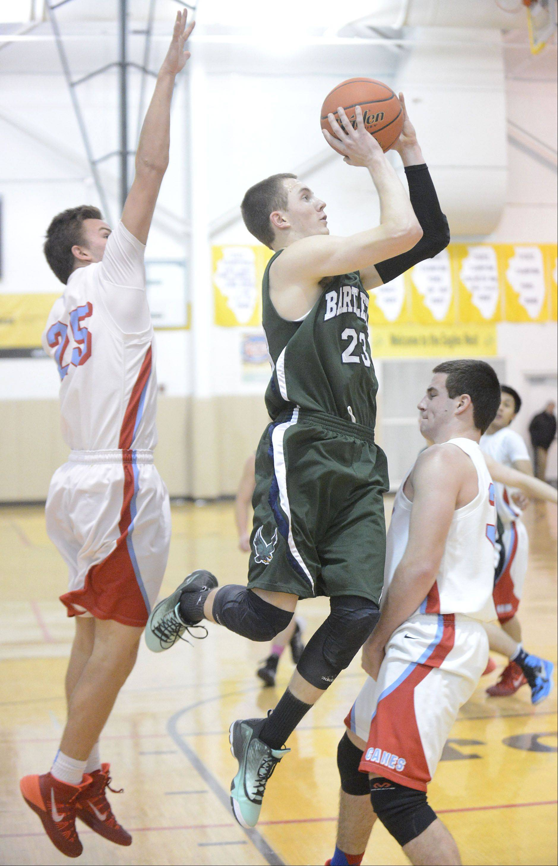 Bartlett's Ryan DiCanio shoots over Marian Central's Matthew Ricchiuto in the first quarter on Saturday, December 21.