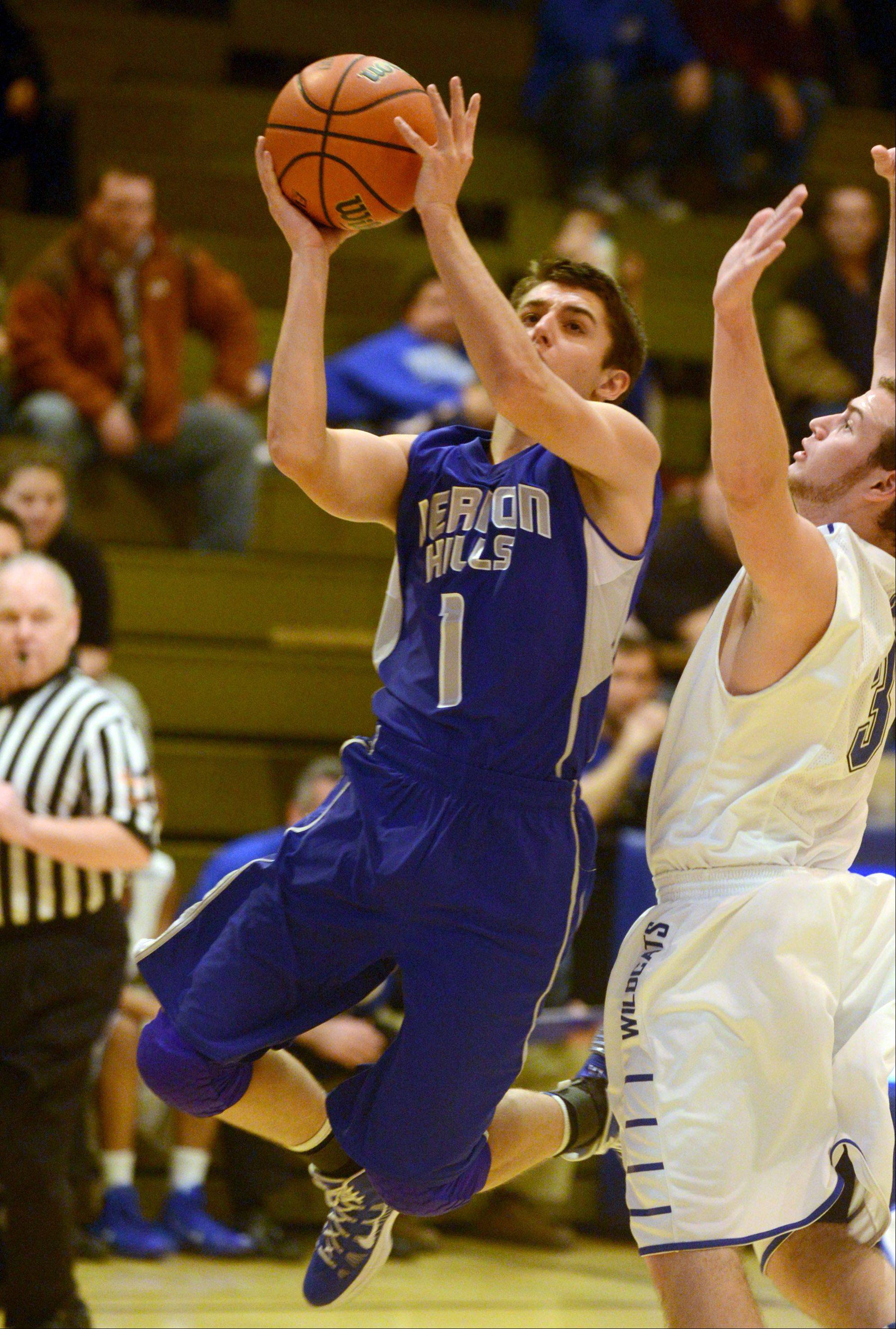 Vernon Hills' Robby Nardini, left, soars to the hoop past Wheeling's Chris Pierro.