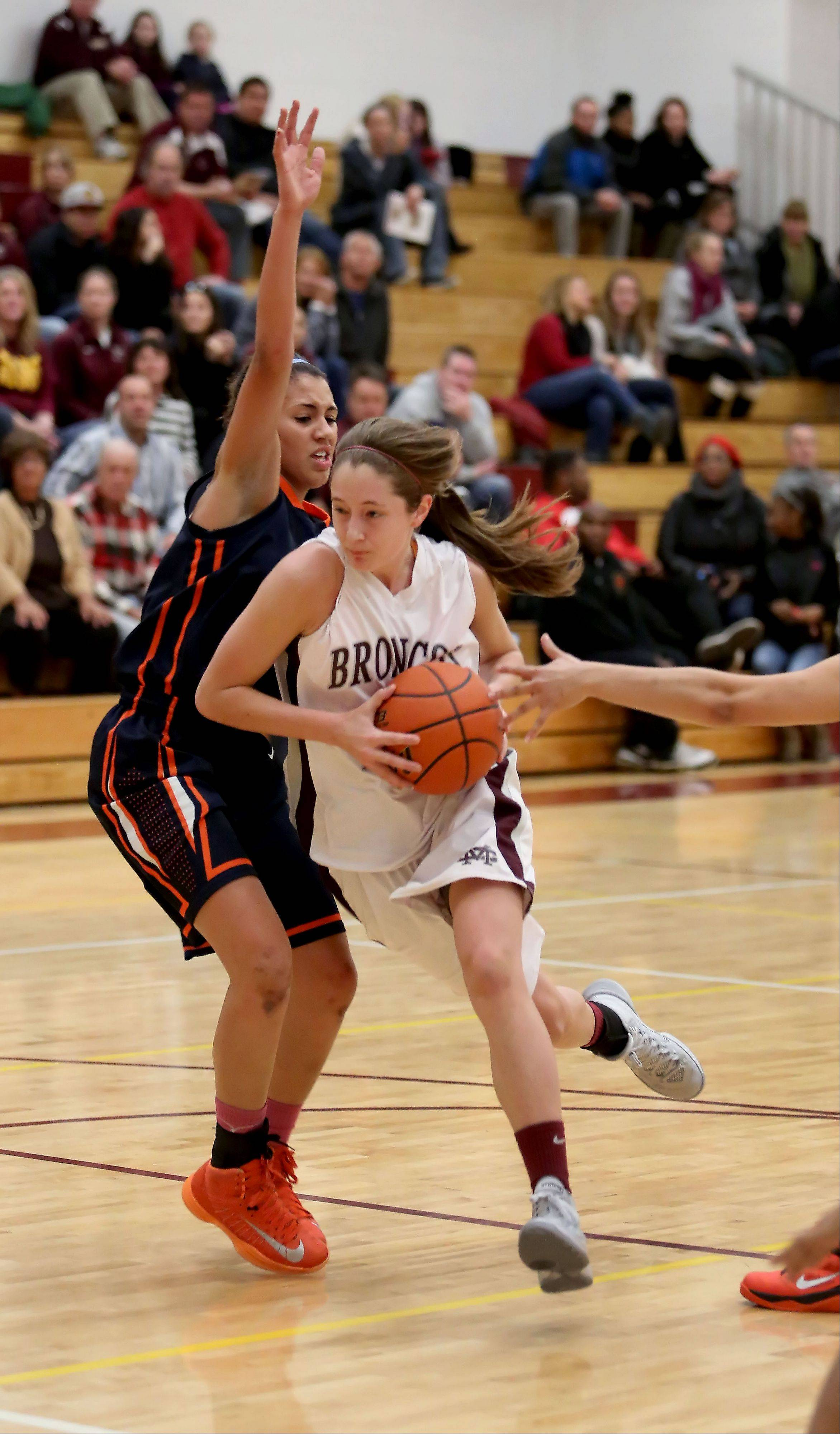 Montini's Kateri Stone drives around Chardonney Harris of Oak Park River Forest.