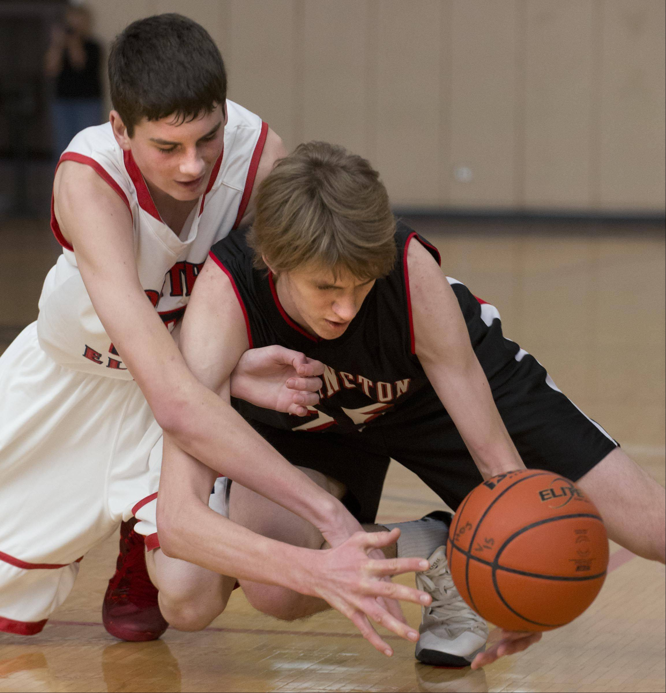 South Elgin's Tyler Hankins, left, and Barrington's Rapolas Ivanauskas compete for a loose ball.