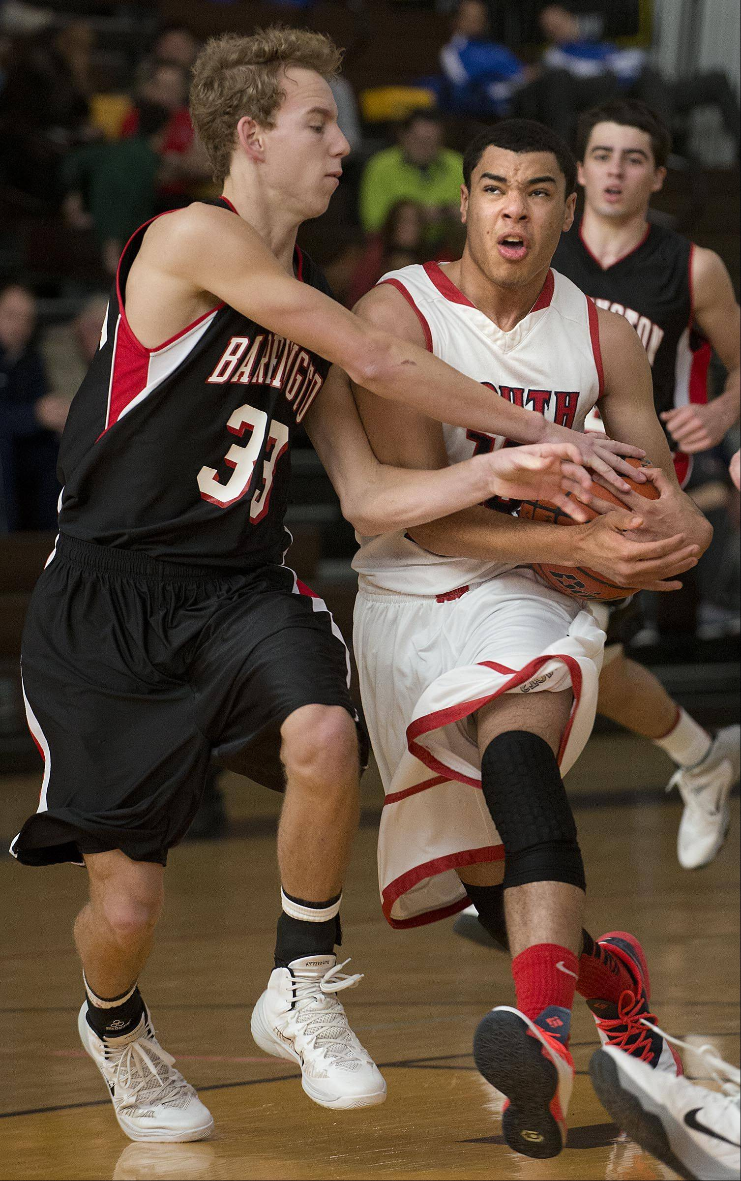 Barrington's Scott Bennett reaches to try to stop South Elgin's Matthew Smith .