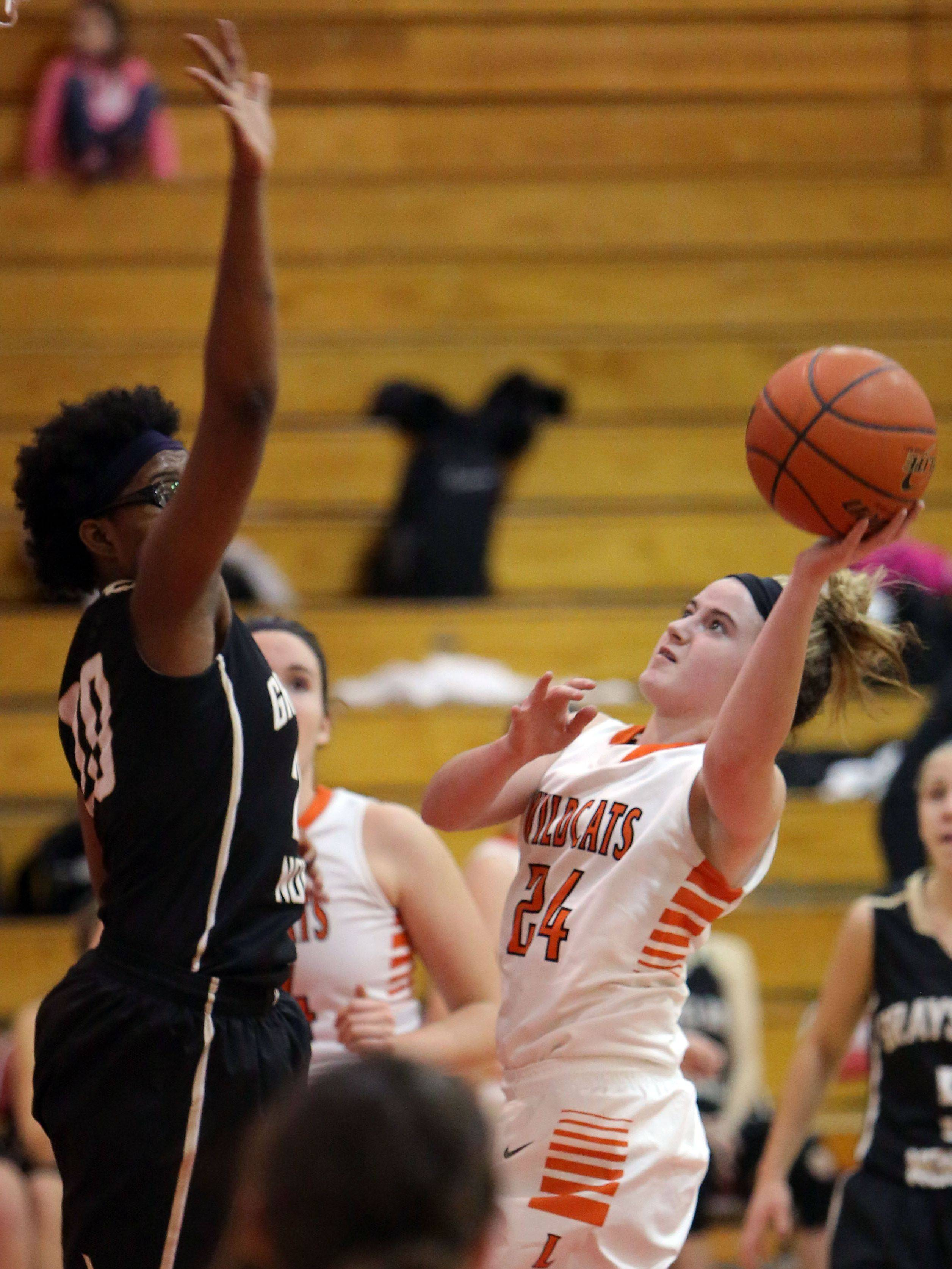 Libertyville's Rosie Lynch, right, drives on Grayslake North's Brittany Thibeaux on Thursday at Mundelein High School.