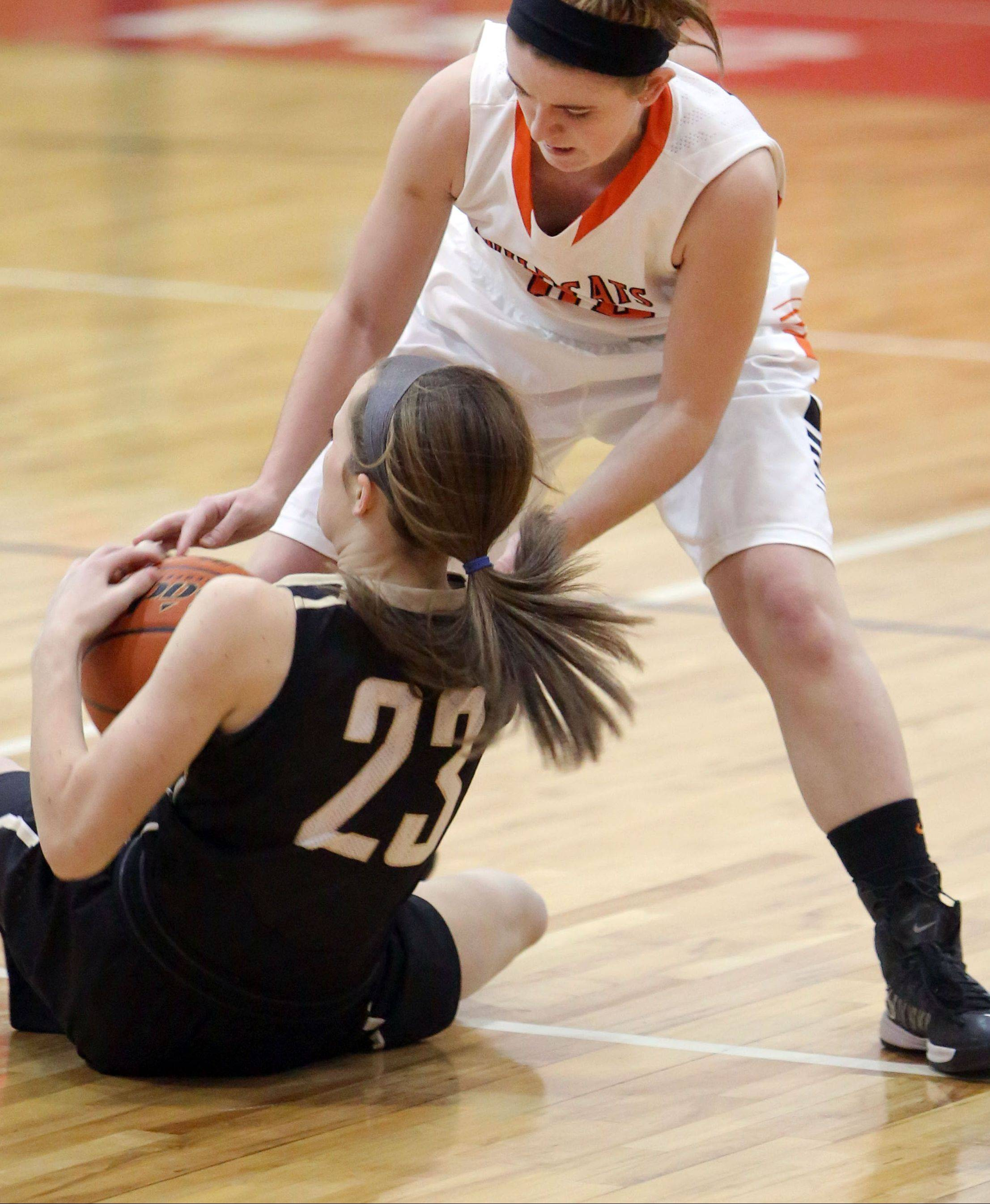 Libertyville's Rosie Lynch, right, and Grayslake North's Sidney Lovitsch battle for a loose ball Thursday at Mundelein.