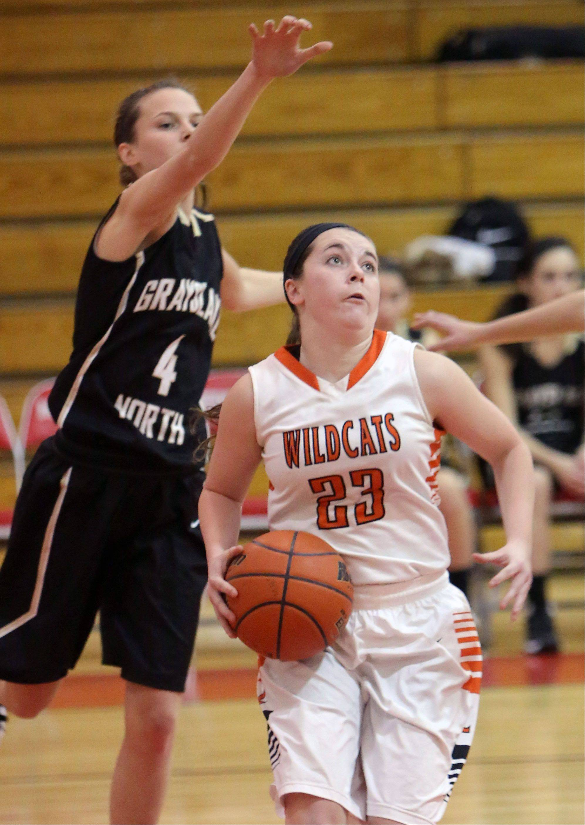Libertyville's Sydney Mudd, right, drives on Grayslake North's Maggie Fish on Thursday at Mundelein.