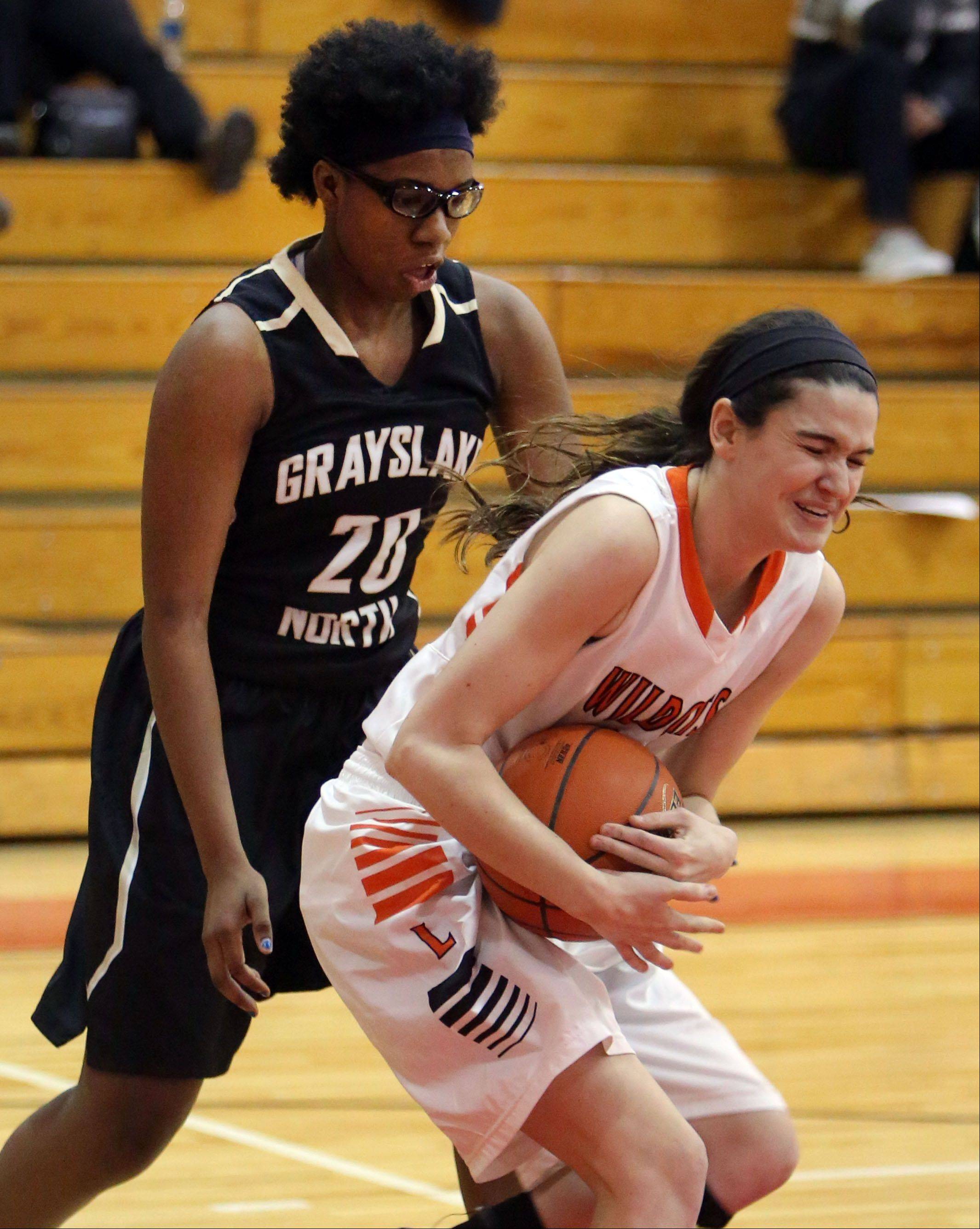 Grayslake North's Brittany Thibeaux, left, defends against Libertyville's Erin Dunleavy on Thursday at Mundelein High School.