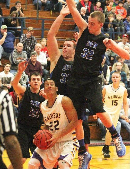 St. Charles North defends Bloomington on Thursday at the Pontiac Holiday Tournament.