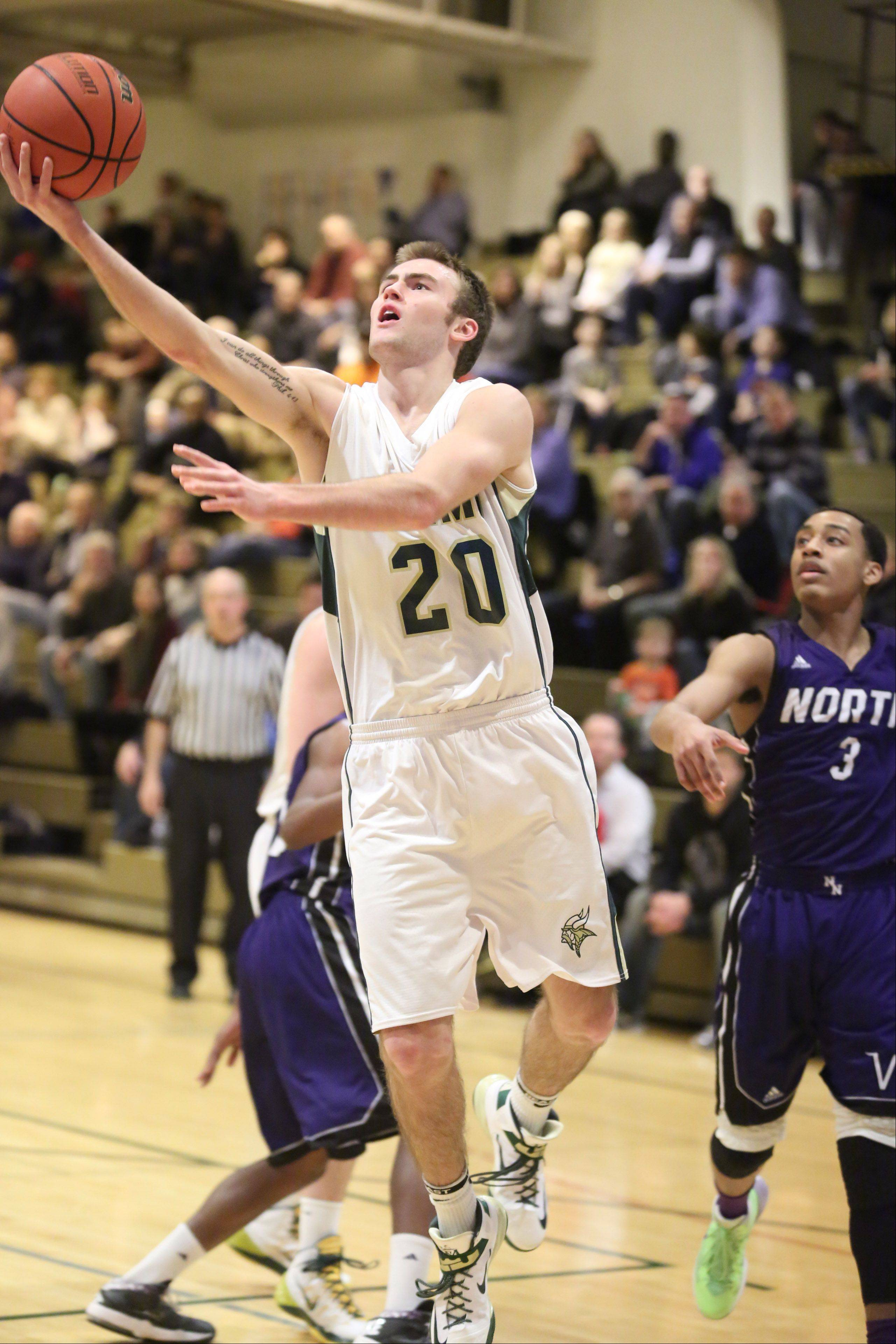 Fremd's Riley Glassmann drives past two Niles North defenders and shoots on Thursday at the Wheeling Hardwood Classic.