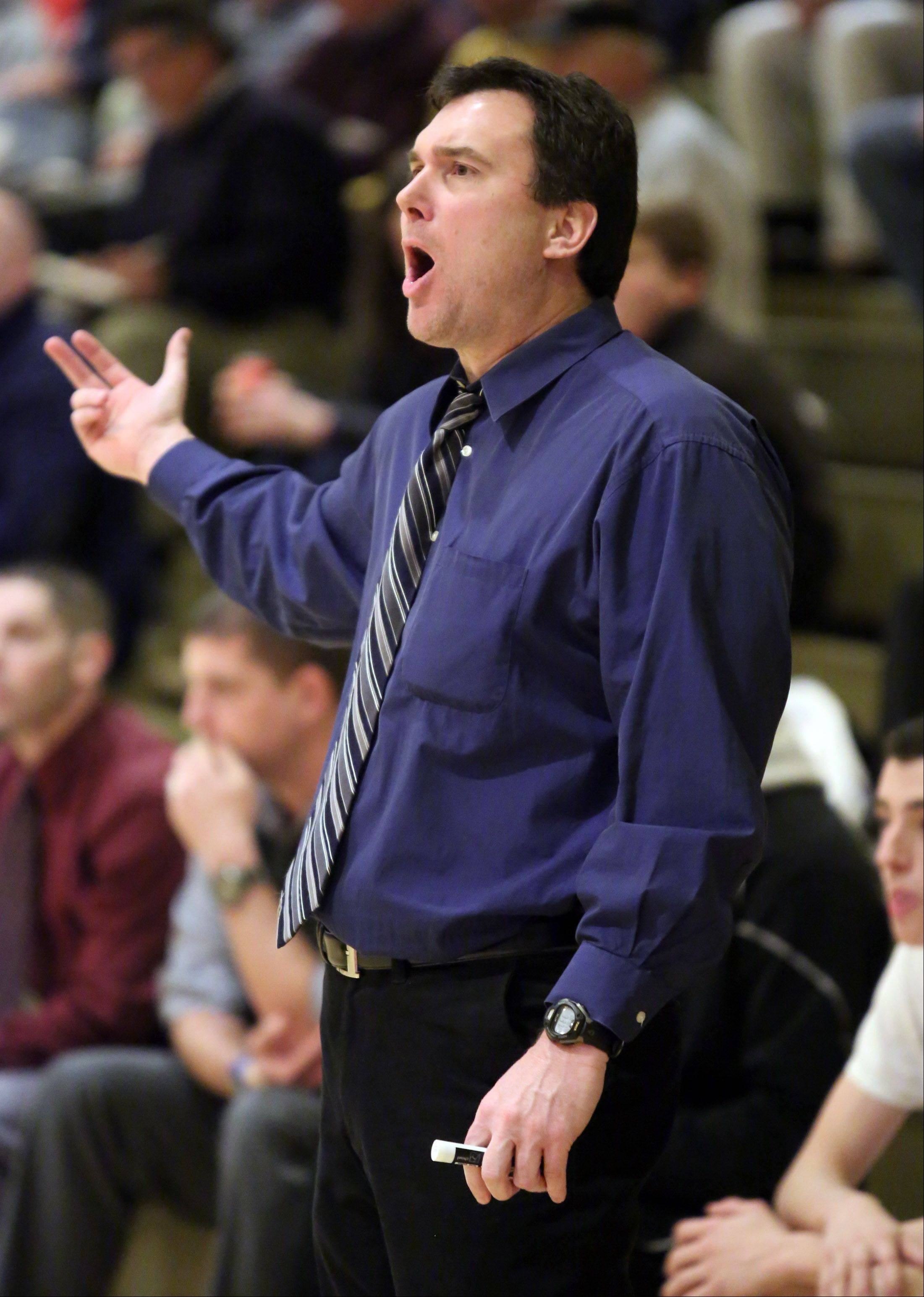 Fremd coach Bob Widlowski reacts to defensive play against Niles North on Thursday at the Wheeling Hardwood Classic.