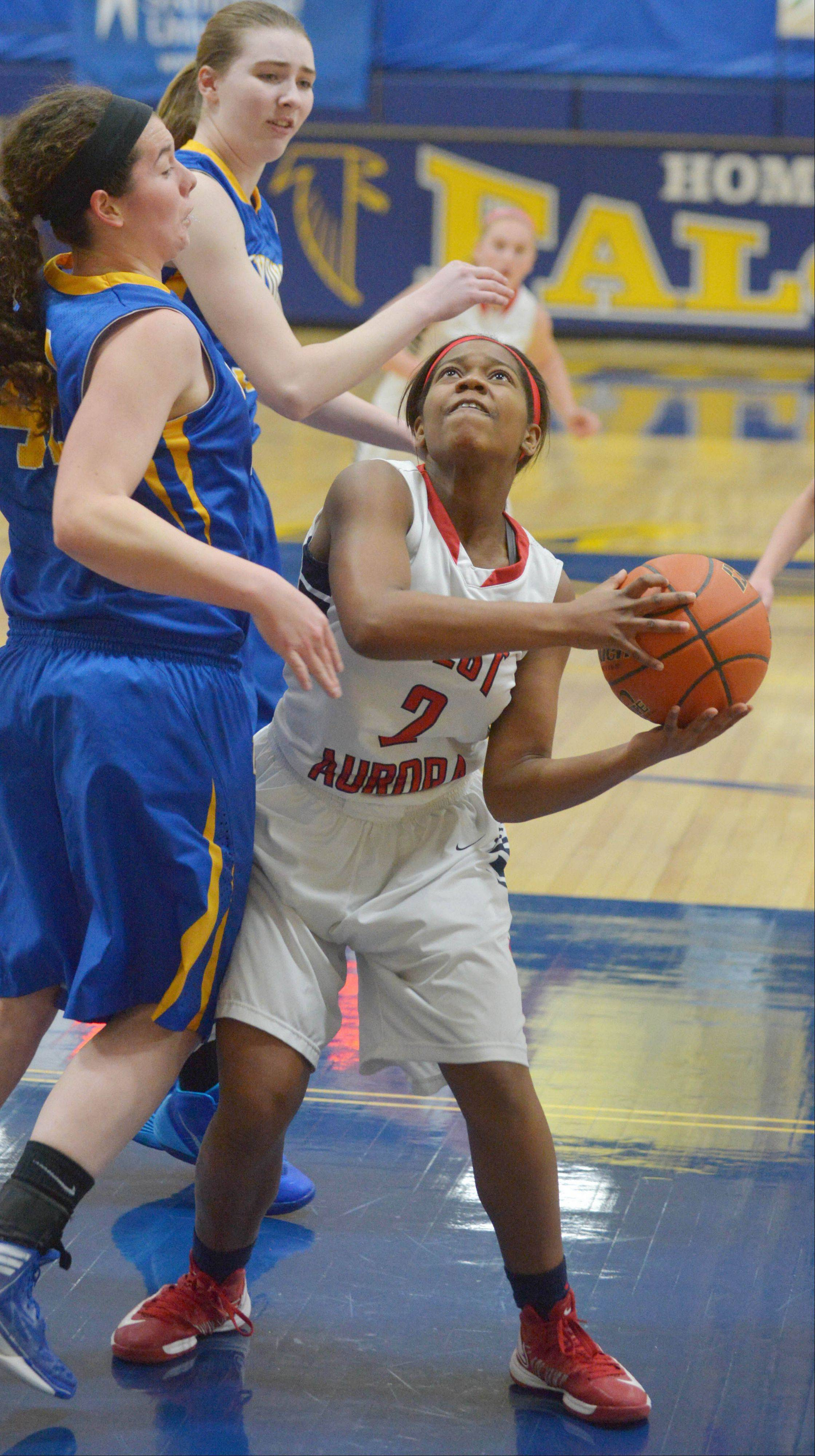 Ashley Williams of West Aurora looks to shoot during the West Aurora at Wheaton North girls basketball tournament game Thursday.