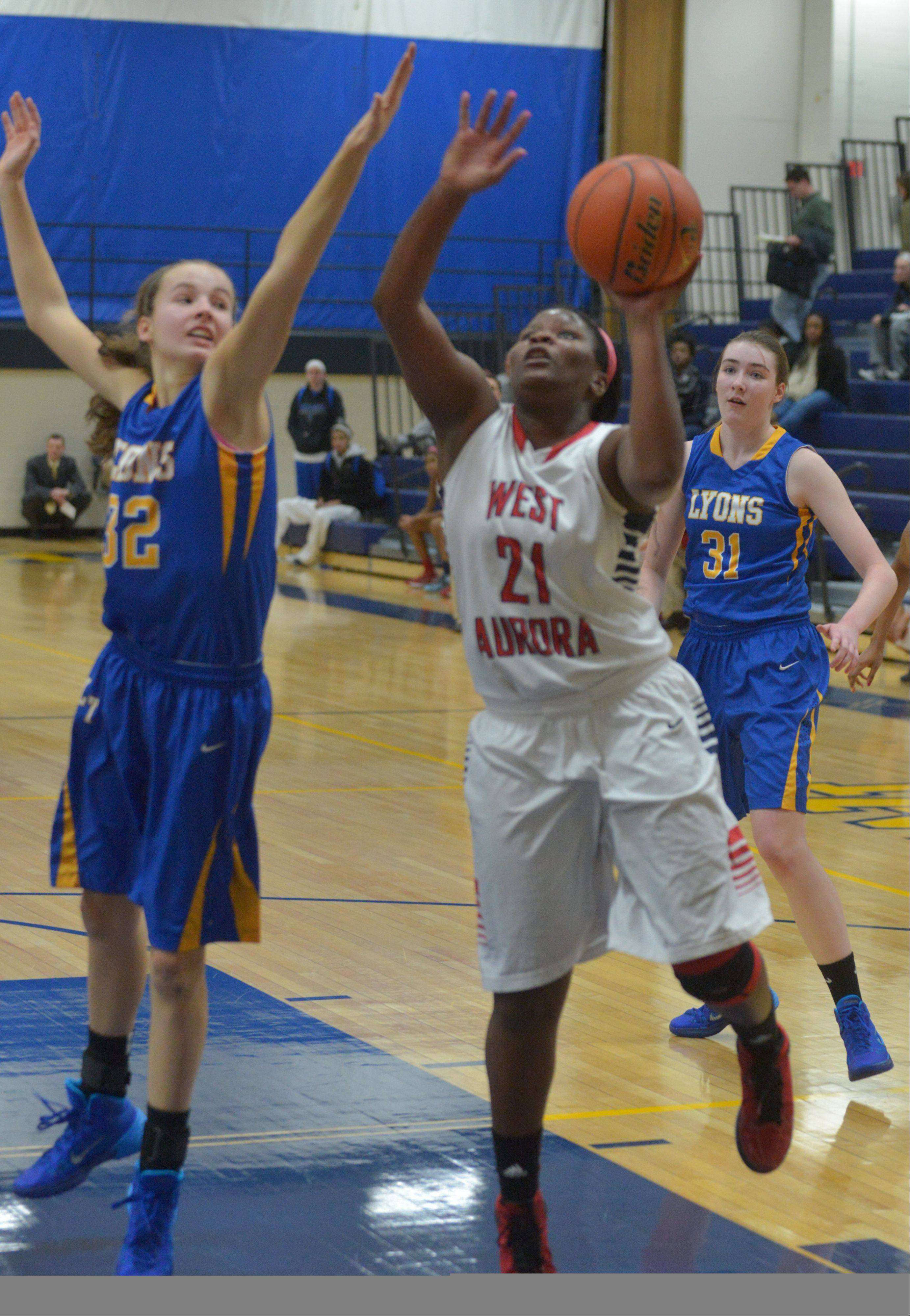 Liz Skaggs drives to the basket Thursday night against Lyons.