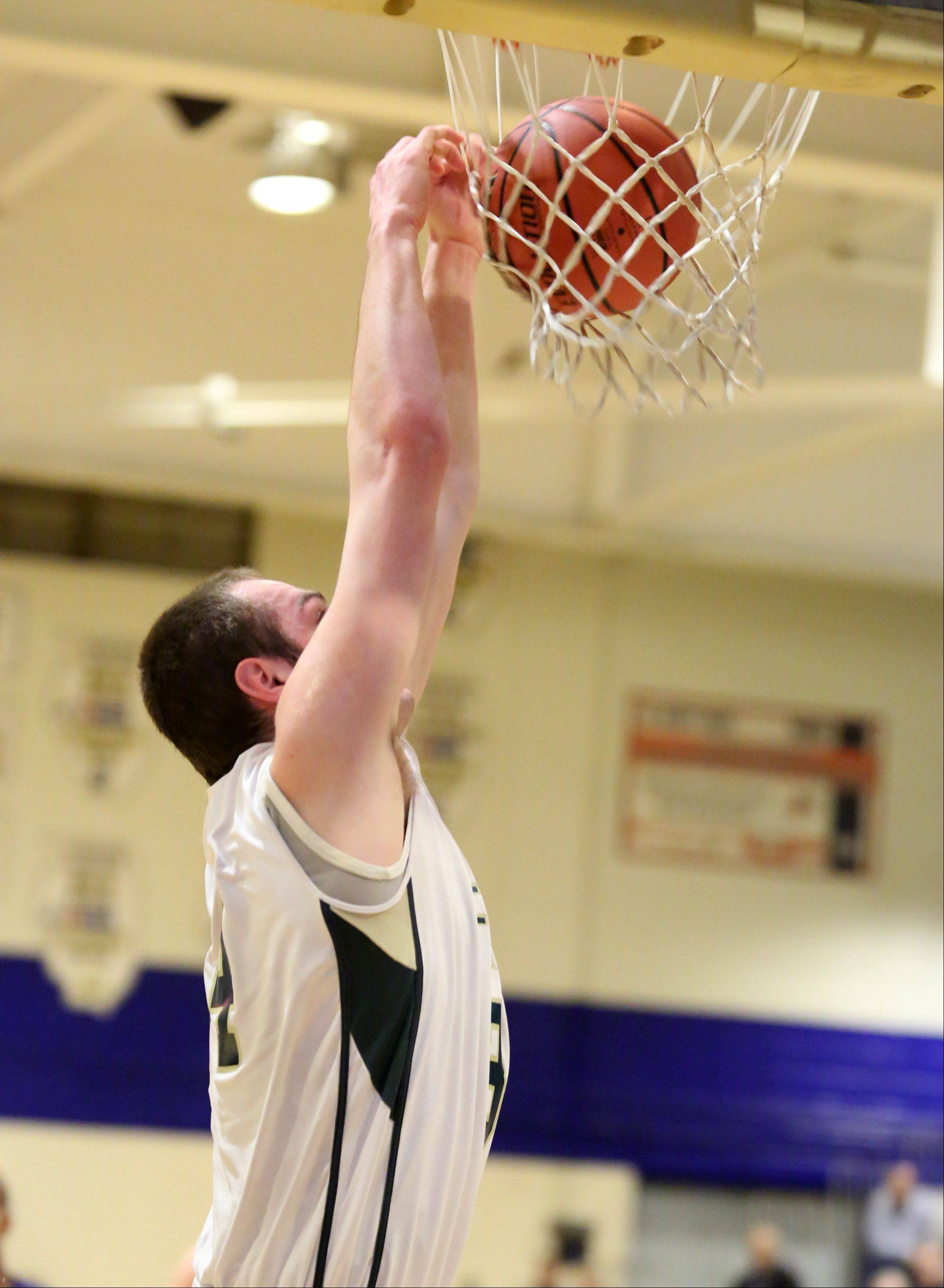 Fremd forward Benjamin Carlson dunks the ball on a breakaway against Niles North on Thursday at the Wheeling Hardwood Classic.