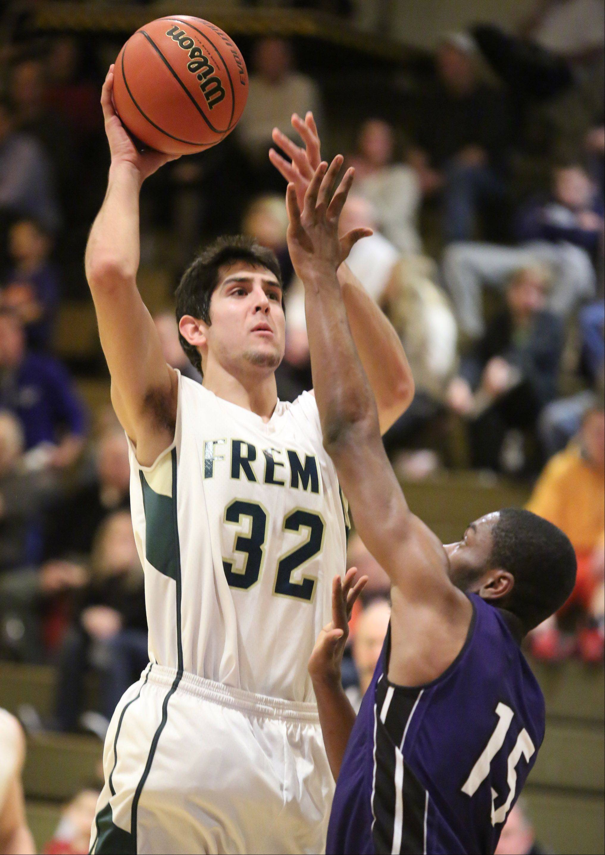 Fremd Matthew Ochoa shoots over Niles North defender Malik Dupree on Thursday at the Wheeling Hardwood Classic.