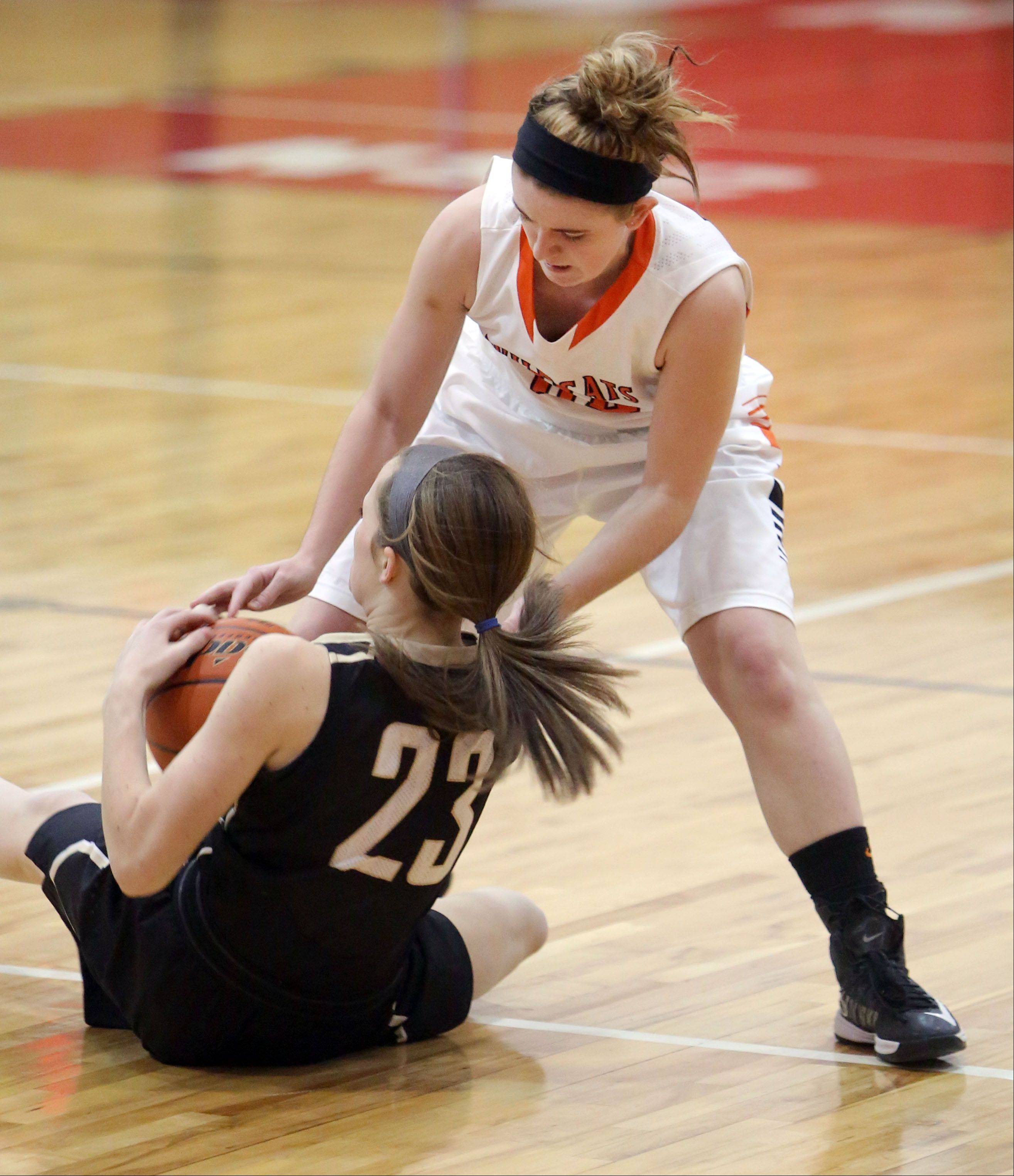 Libertyville's Rosie Lynch, right, and Grayslake North's Sidney Lovitsch battle for a loose ball during their game Thursday at Mundelein High School.