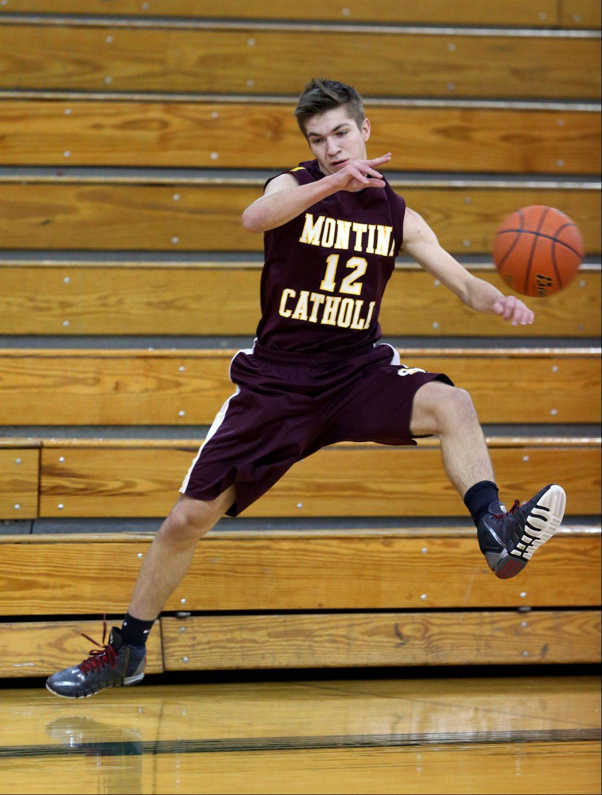 Montini's David Alden looks to pass the ball back in-bounds against Fenton during the 12th annual Glenbard West Holiday Classic boys basketball tournament.