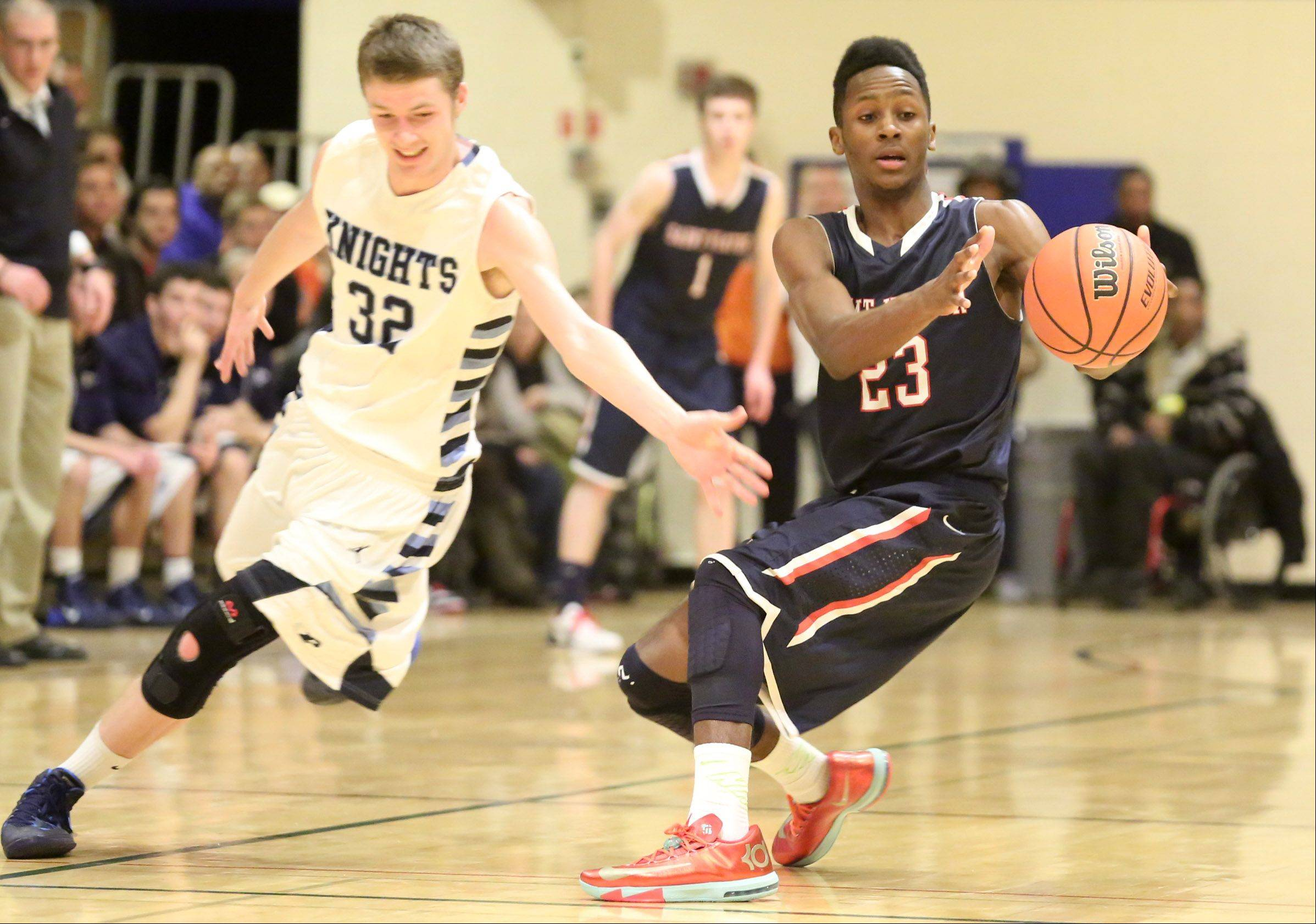 St. Viator guard Ore Arogundade pulls in a pass before Prospect defender Danny Thomas can step in at the Wheeling Hardwood Classic on Friday.