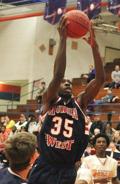 West Aurora's Roland Griffin drives for a basket Friday at the Pontiac Holiday Tournament.