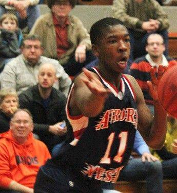 West Aurora's Jontrel Walker finds a teammate Friday at the Pontiac Holiday Tournament.
