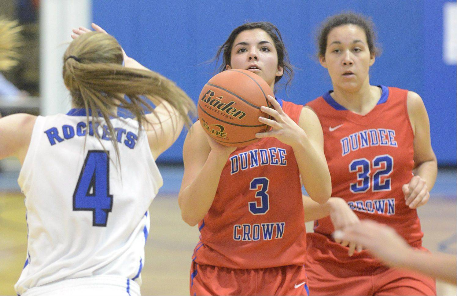 Burlington Central's Kayla Ross attempts to block a shot by Dundee-Crown's Francesca Scarpelli in the second quarter on Friday.