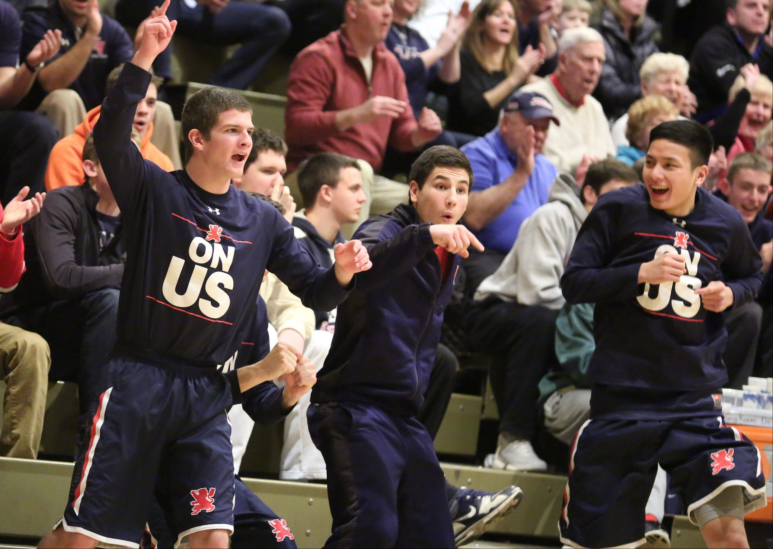 The St. Viator bench celebrates a three-point shot against Prospect at the Wheeling Hardwood Classic on Friday in Wheeling.