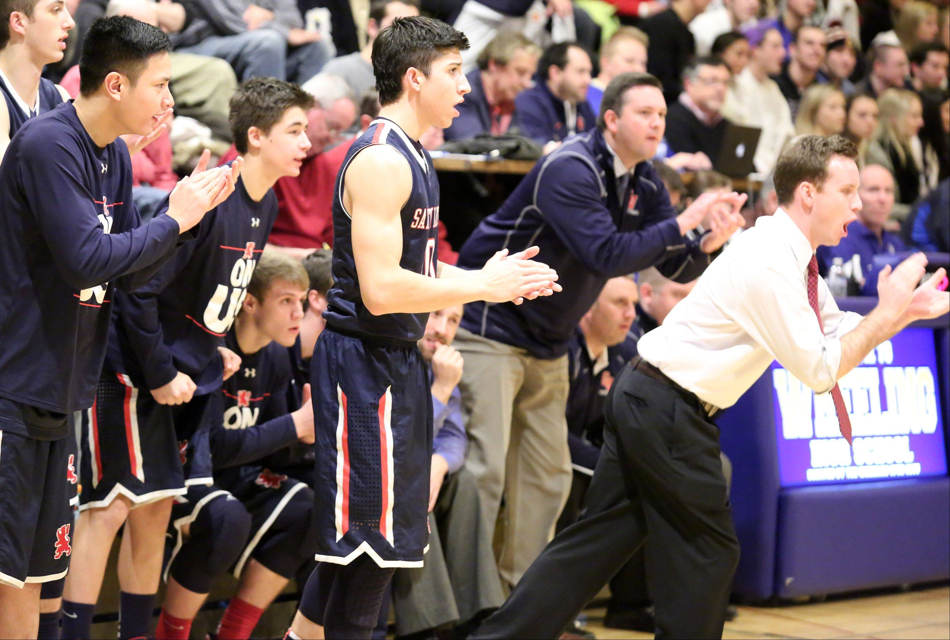 St. Viator head coach Mike Howland and players celebrate a score against Prospect at the Wheeling Hardwood Classic on Friday in Wheeling.