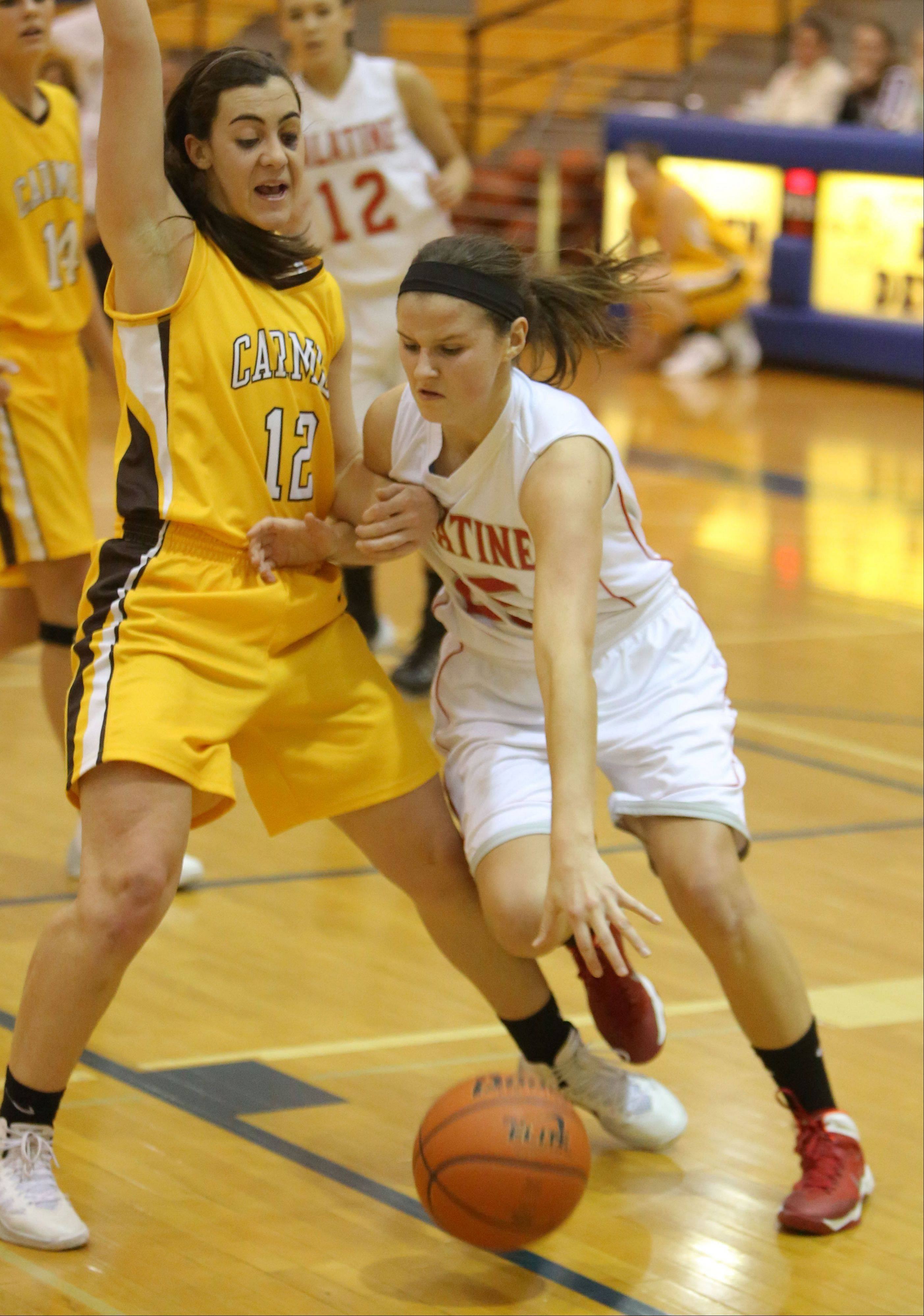 Palatine's Erin Mayer, right, drives on Carmel's Kathleen Felicelli during their game Friday at Warren High School.