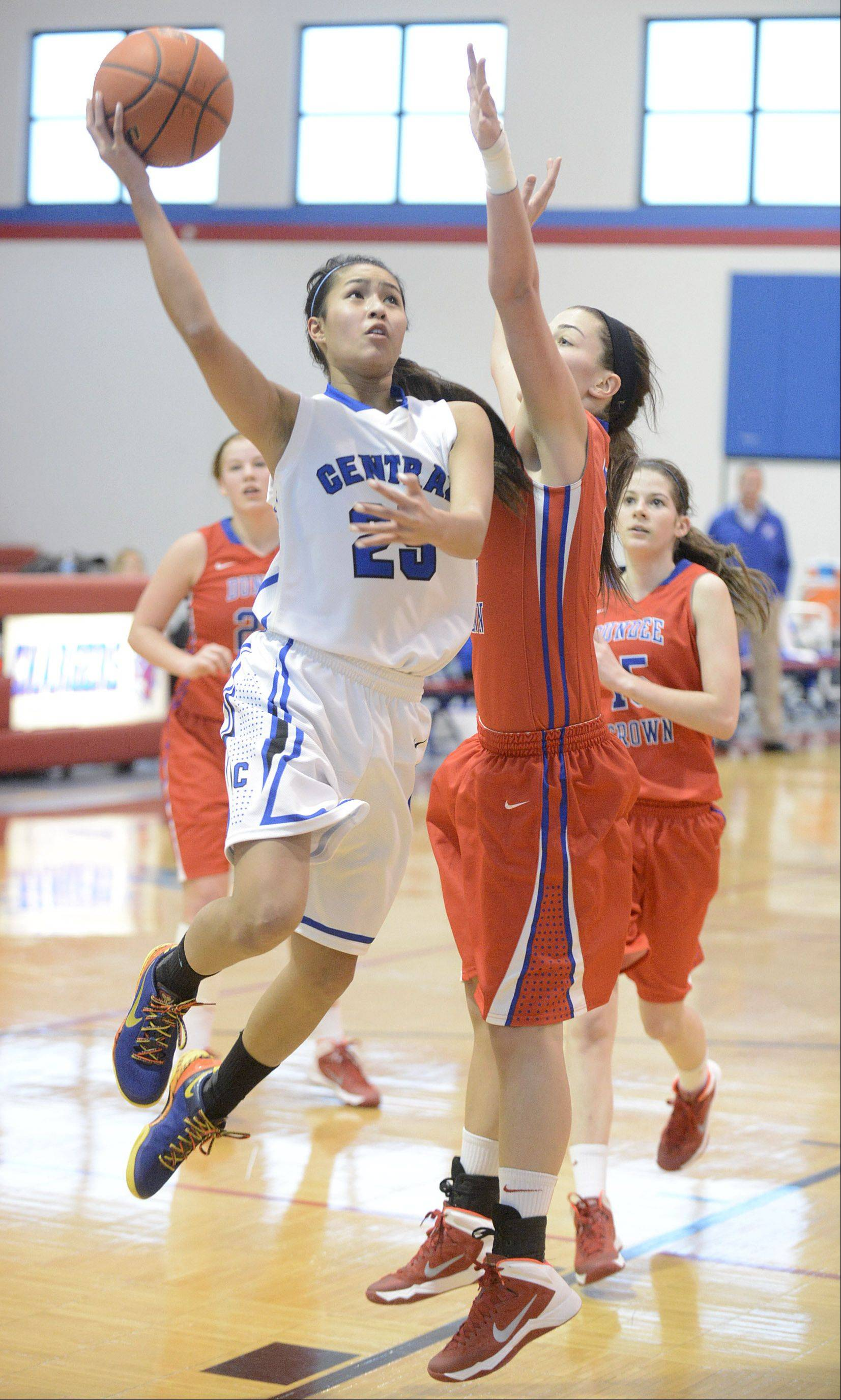 Burlington Central's Sam Cruz shoots over a block by Dundee-Crown's Lauren Lococo in the second quarter on Friday, December 27.