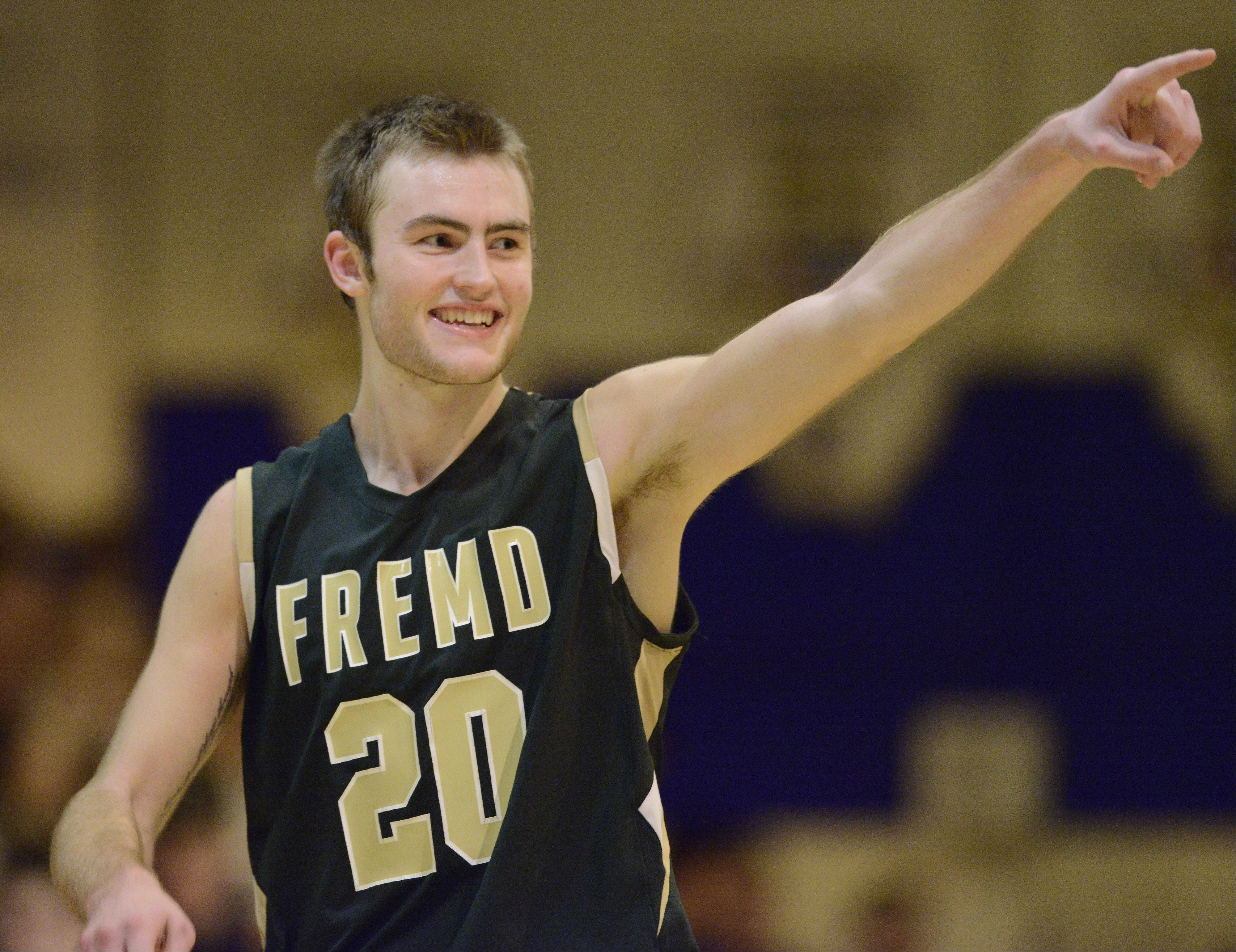 Fremd's Riley Glassmann celebrates after his team topped St. Viator 77-67 to win the Wheeling Hardwood Classic on Saturday night.