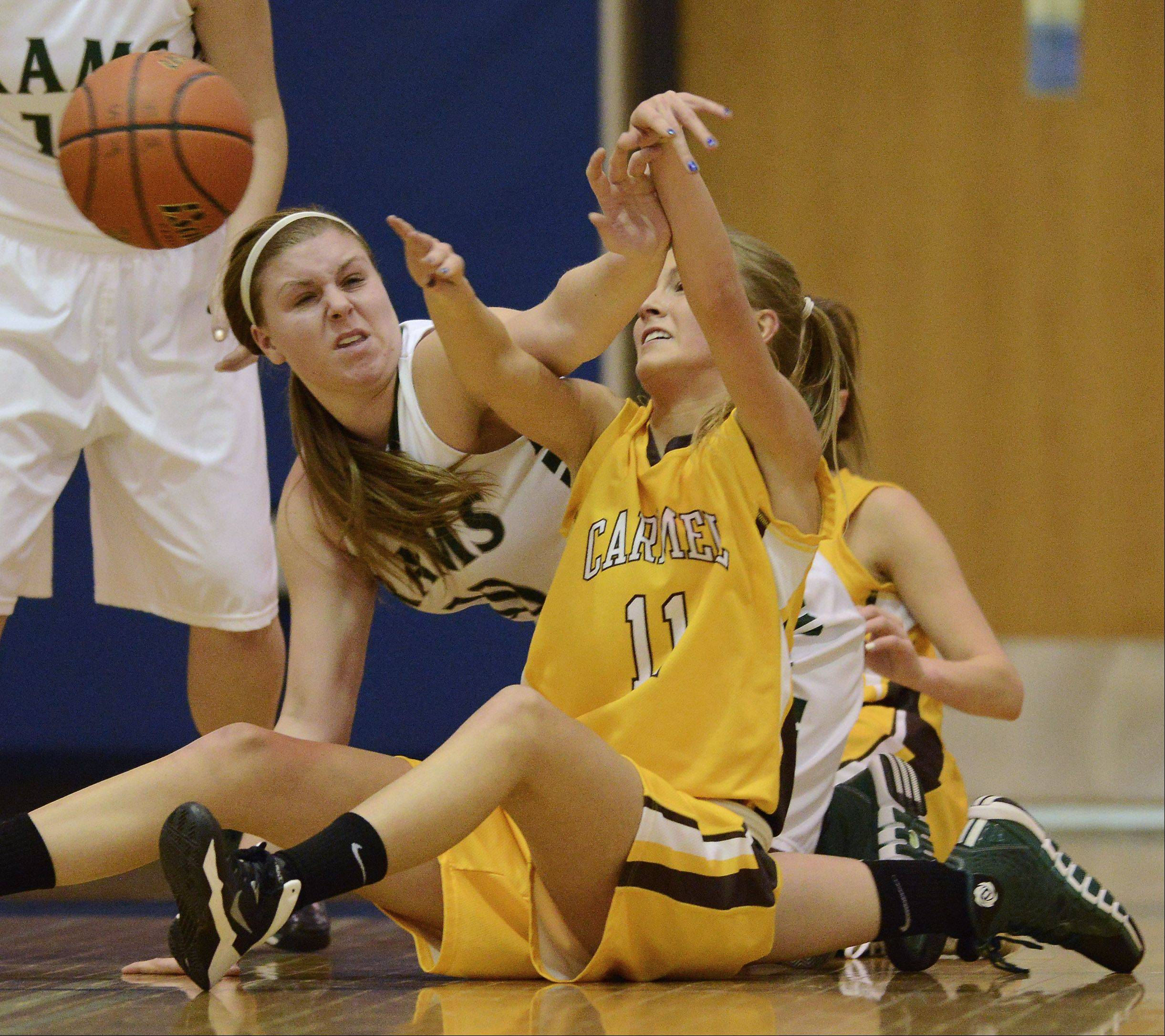 Carmel's Leah Lach, right, tries control a loose ball as Graylake Central's Maddy Miller deflects the pass Saturday at Warren.